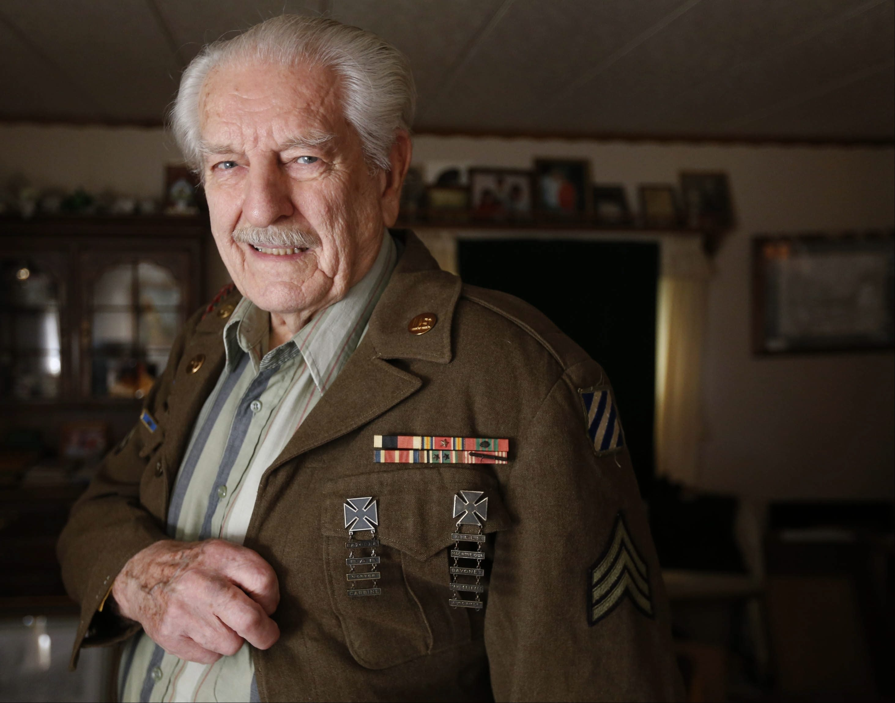 Roy Nieman, at home in Cheektowaga, still fits into his Army uniform from WWII. He was in the Battle of the Bulge, and one particular concussion bomb has had an effect ever since.