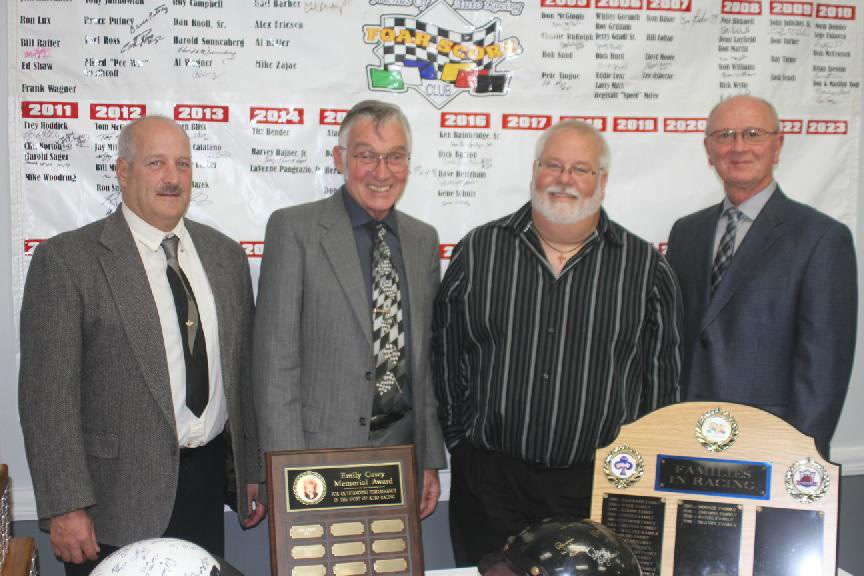 From left, Dave Heitzhaus, Gene Schulz, Ken Bainbridge Jr. (representing his father) and Randy Anderson (representing Dick Barton) accept their FOAR Score Hall of Fame awards on Saturday.