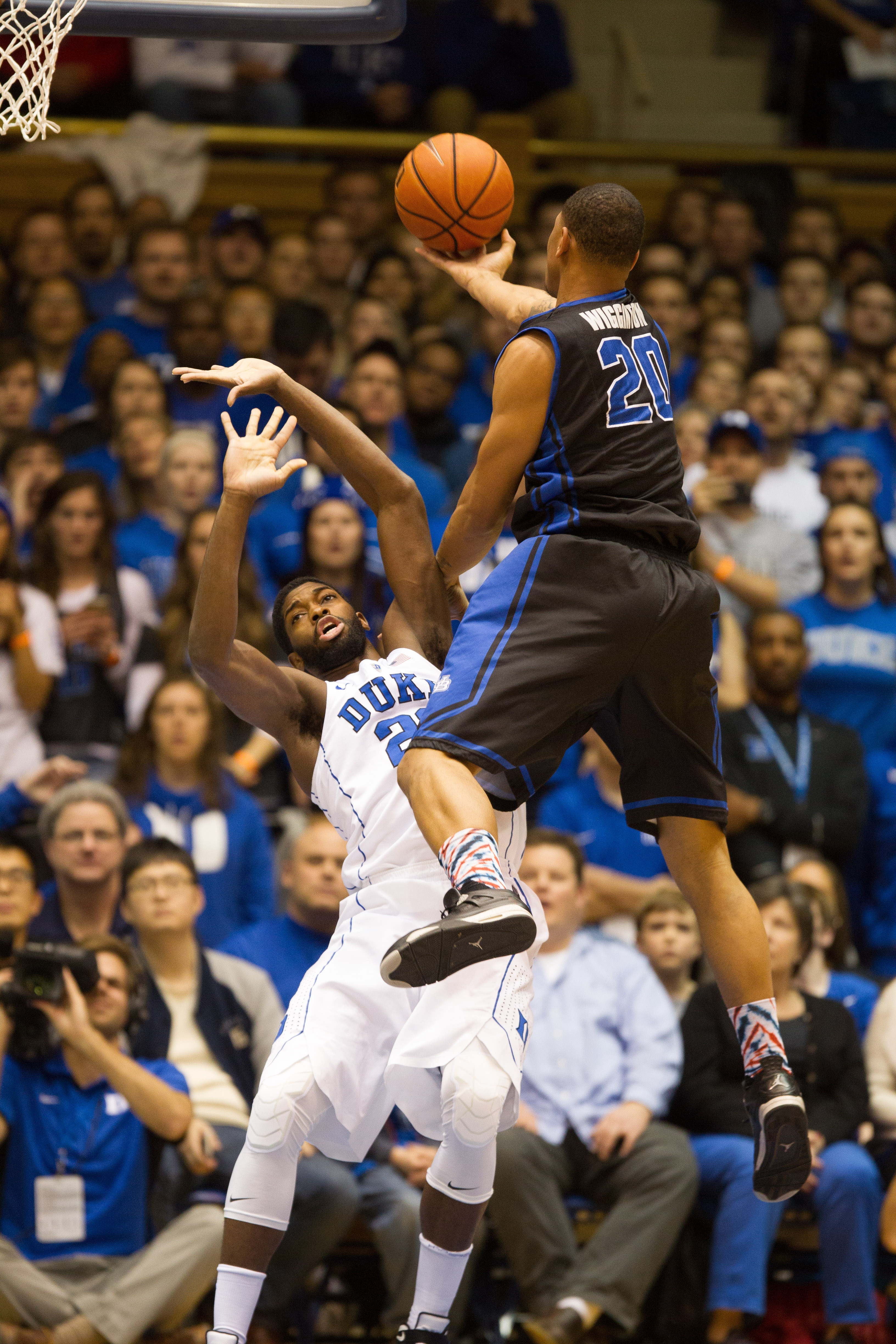UB's Rodell Wigginton drives to the basket against Duke's Amile Jefferson on Saturday in Durham, N.C.