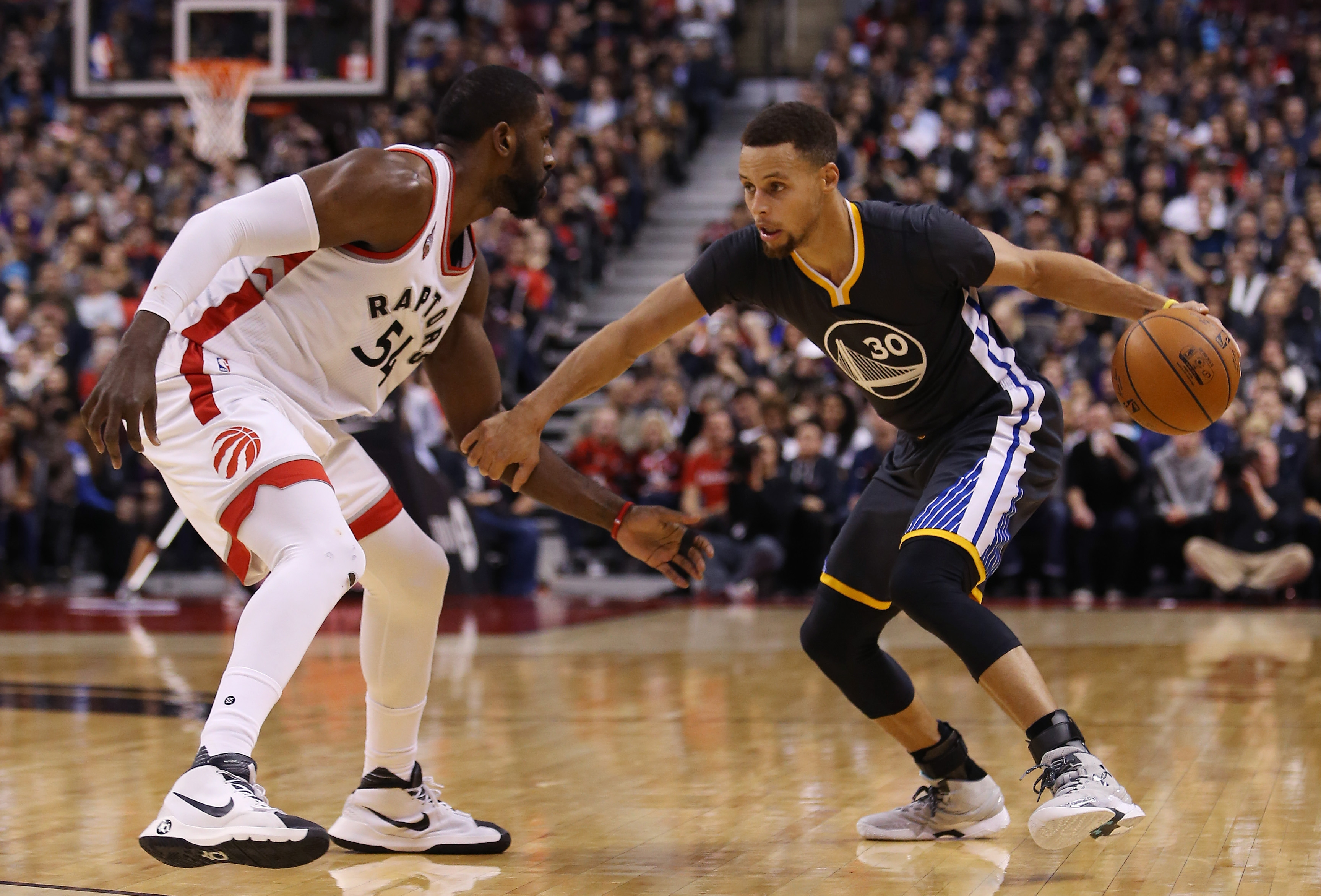 Stephen Curry, trying to dribble around Toronto's Patrick Patterson, had nine more three-pointers in the Warriors' 112-109 victory.