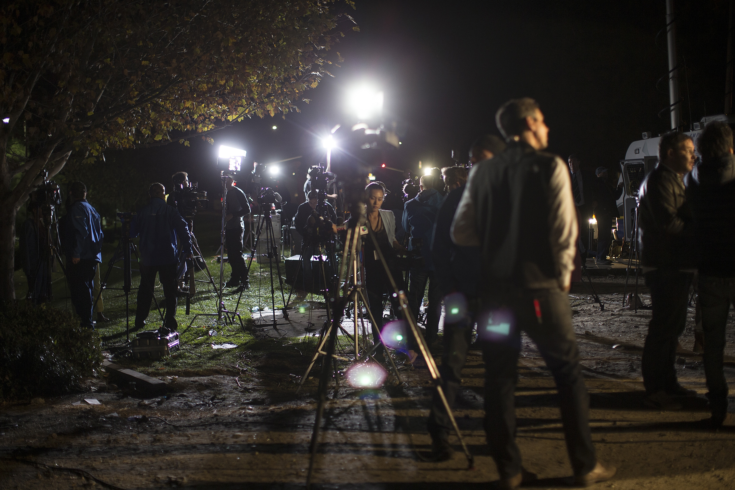 Hundreds of media gather await a news conference half a mile from the mass shooting scene where 14 people were killed at the Inland Regional Center on Wednesday in San Bernardino, Calif.