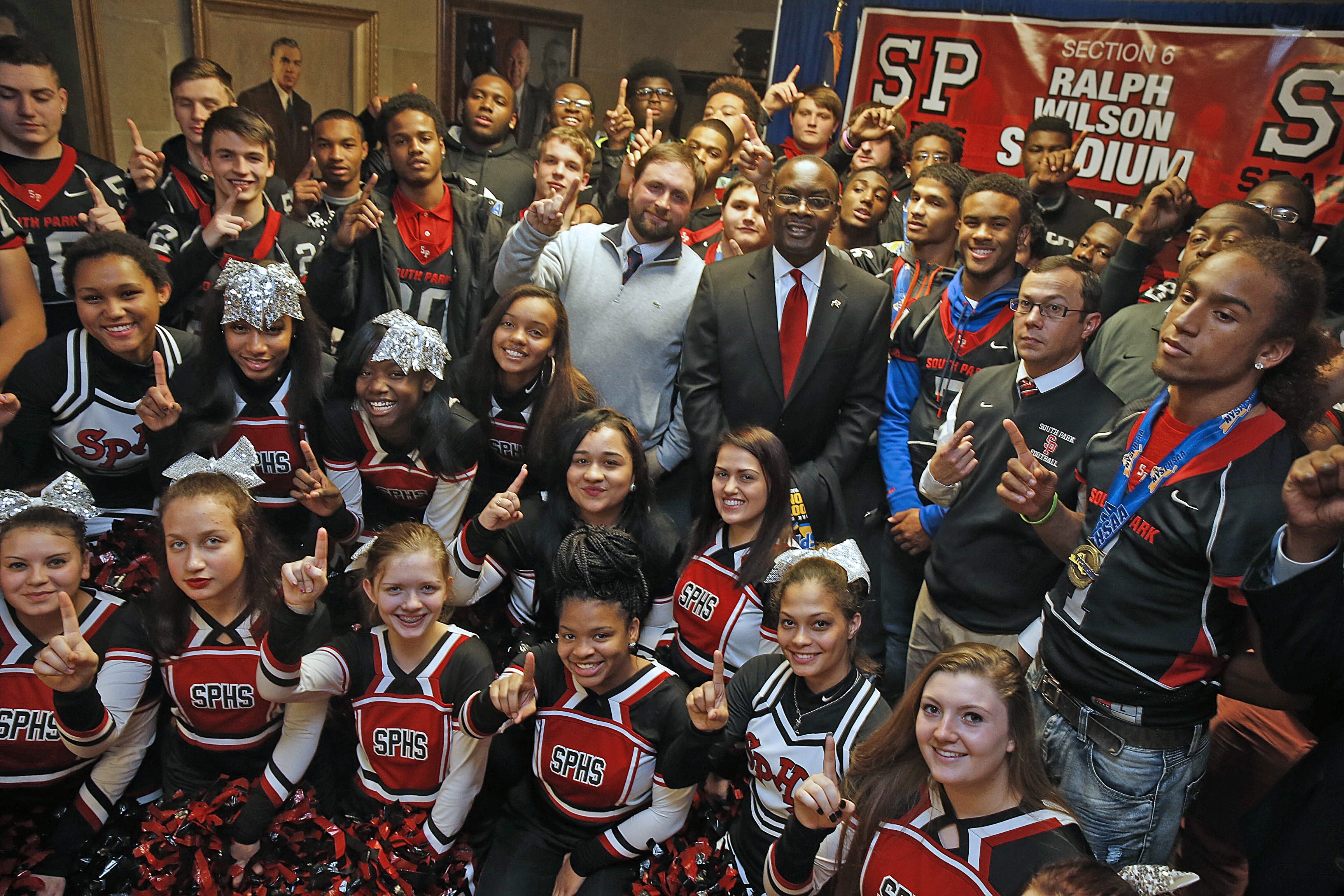 Mayor Byron Brown, center, with South Park coach Timothy Delaney on his right, welcomed state champions to City Hall.