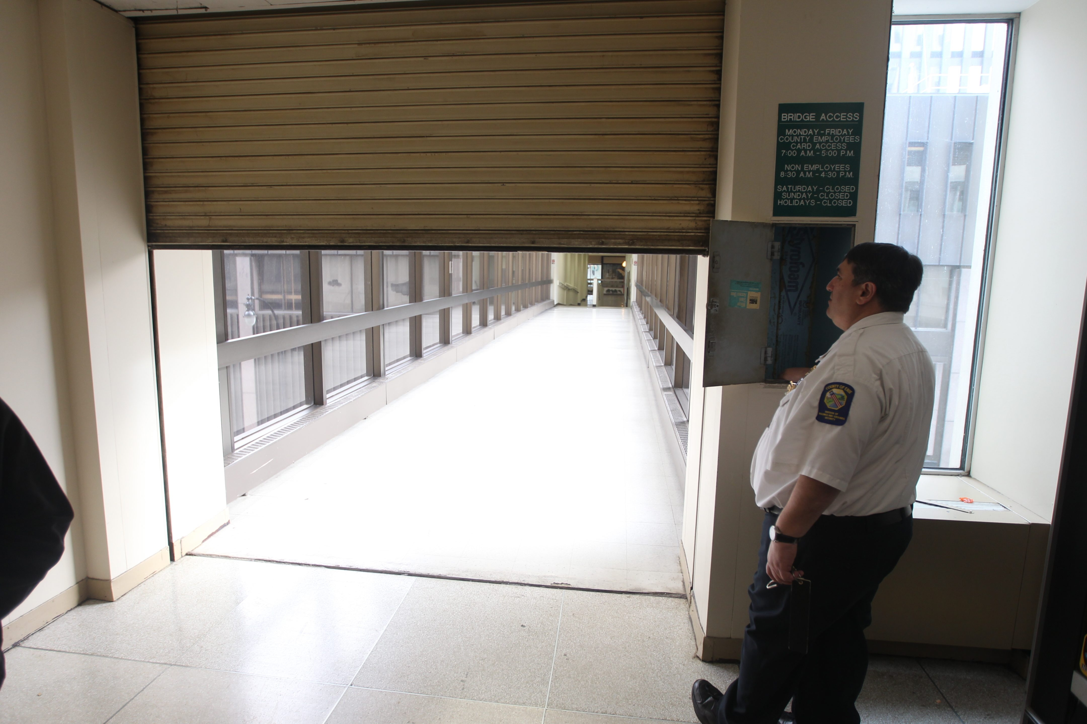 Erie County Building and Grounds Supervisor Robert Bruno closes the door to the pedestrian bridge walkway between the Rath Building and the Main Place Mall on Dec. 3.