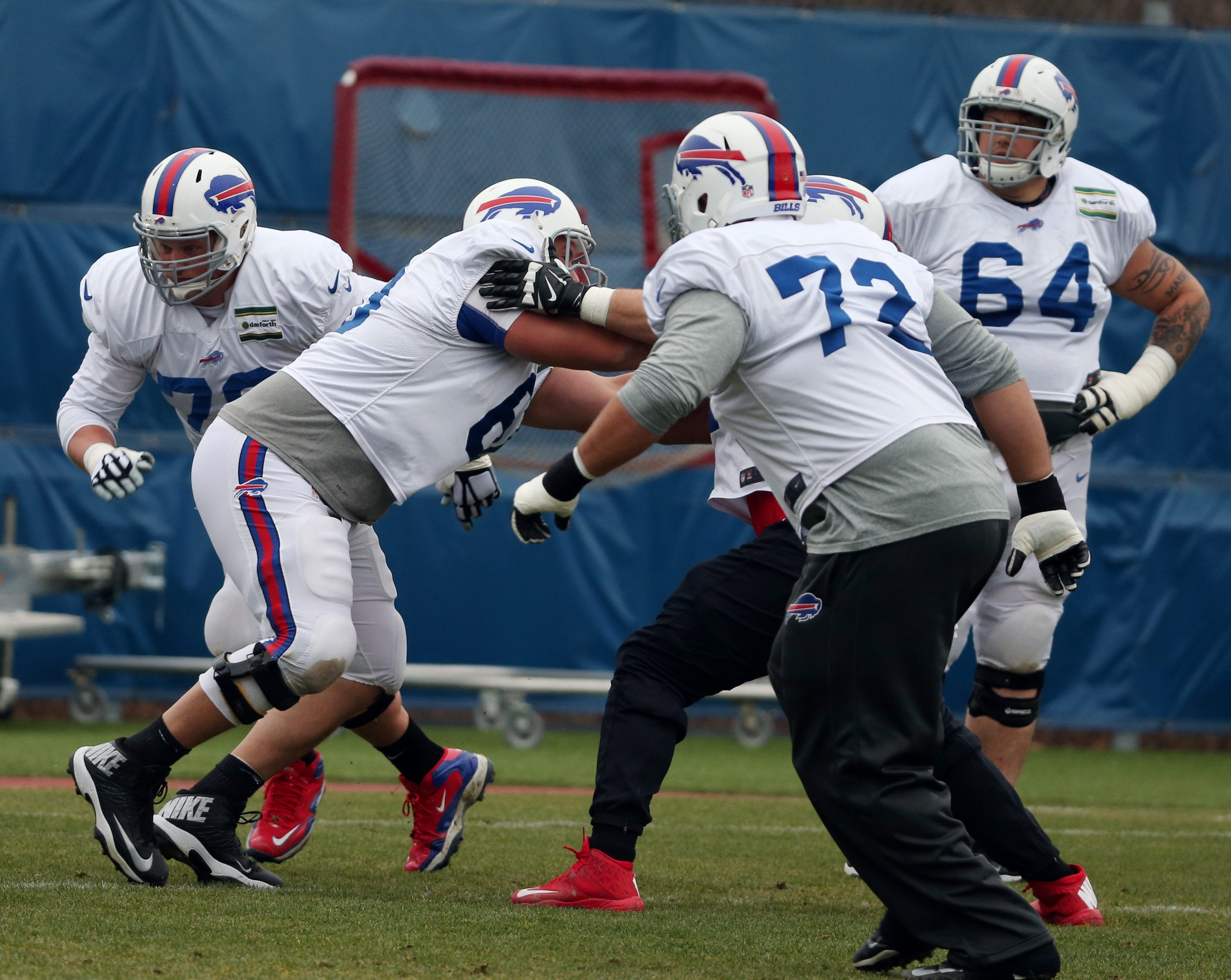 Richie Incognito and Eric Wood maintain that a woe-is-me attitude is not prevalent with Bills offensive linemen, shown working out in practice on Wednesday.
