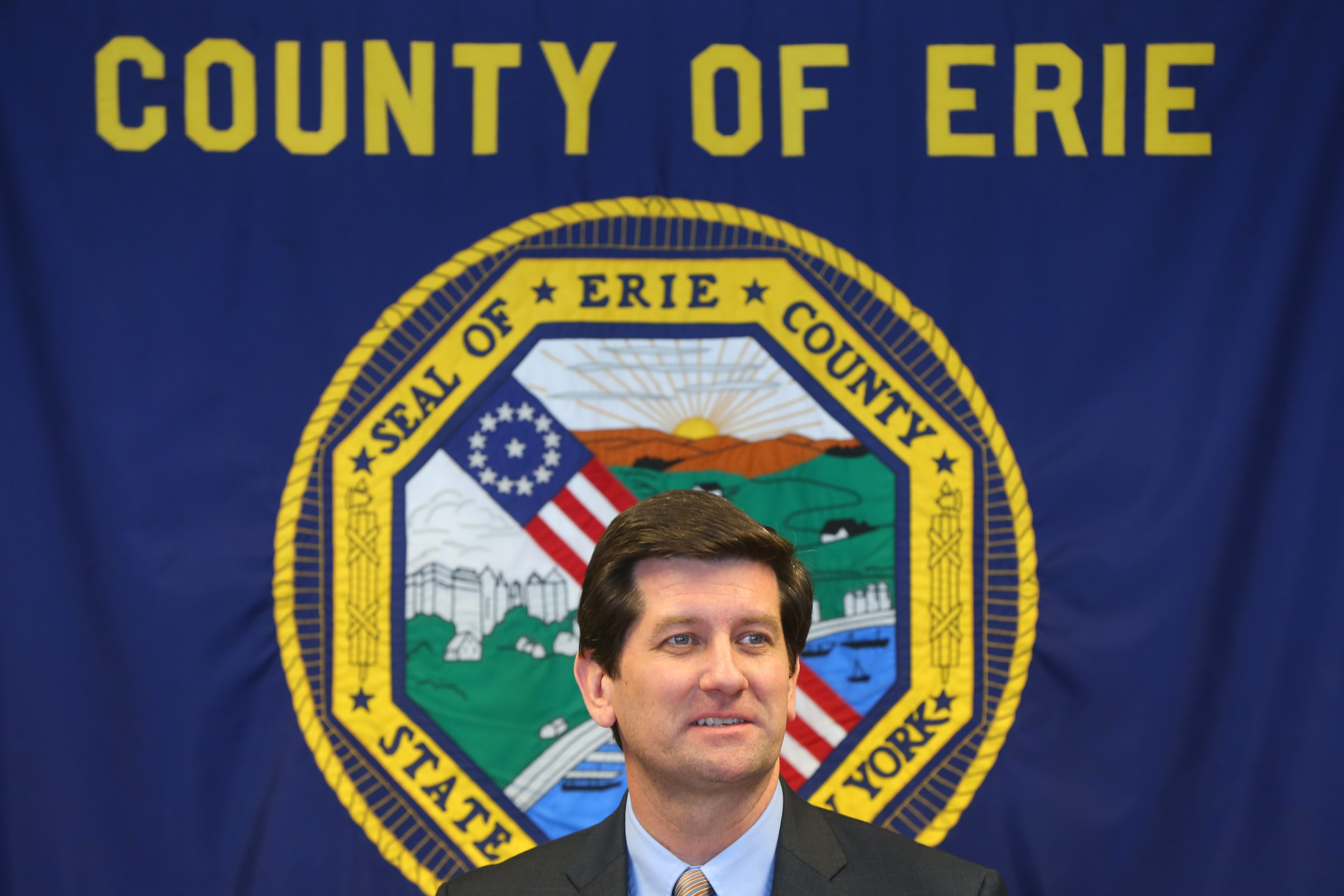 The Erie County Legislature cut five of County Executive Mark C. Poloncarz's 22 proposed new positions in the 2016 budget, which passed Tuesday.