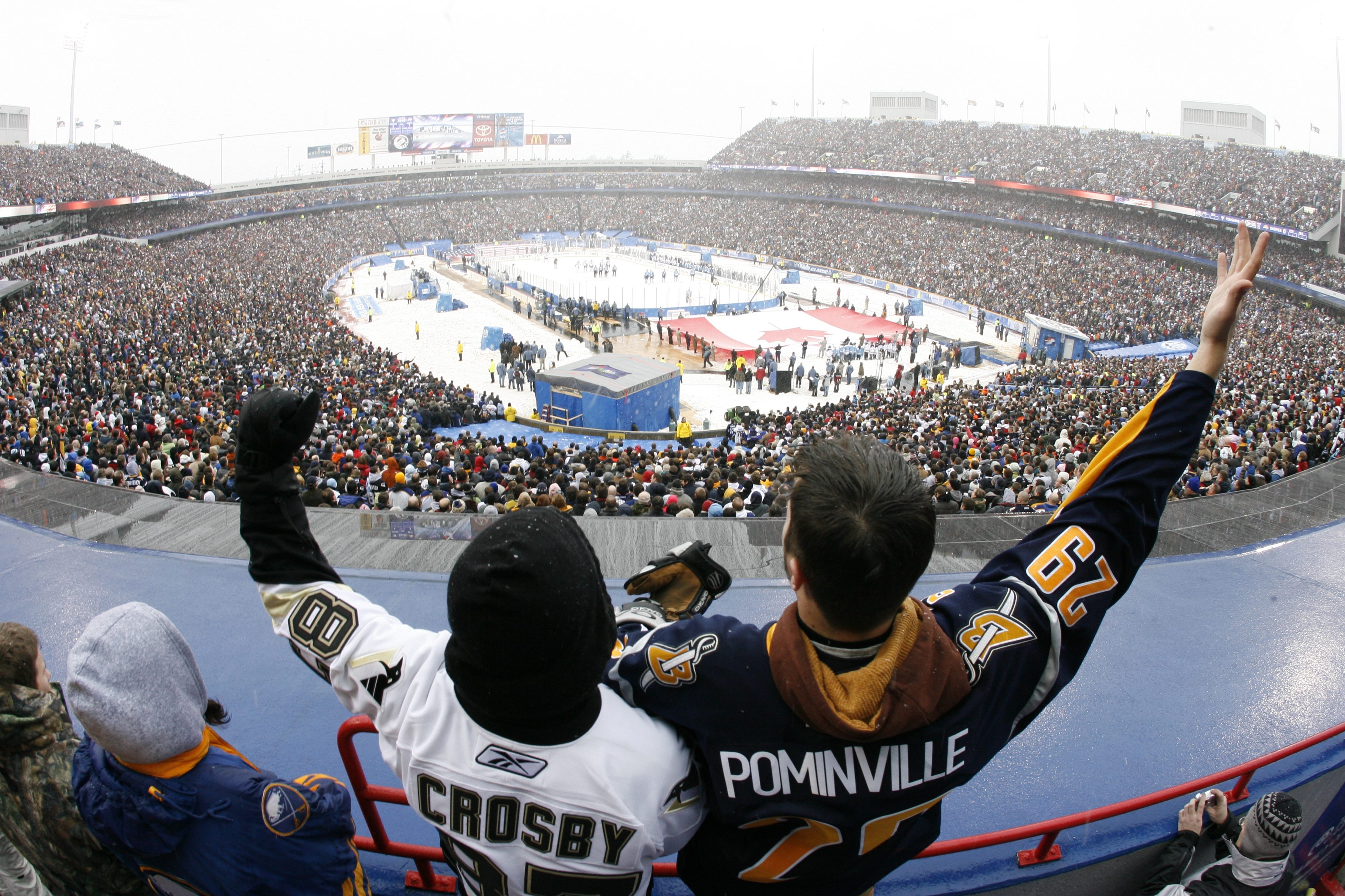 2 lien cut hereJon Williams from Clarence, left, and Mike Bognar of Buffalo do some pregame bonding in the upper deck during the singing of' God Bless Americabefore the NHL's Winter Classic at Ralph Wilson Stadium in Orchard Park. Photo taken Jan. 1, 2008, by Harry Scull Jr.