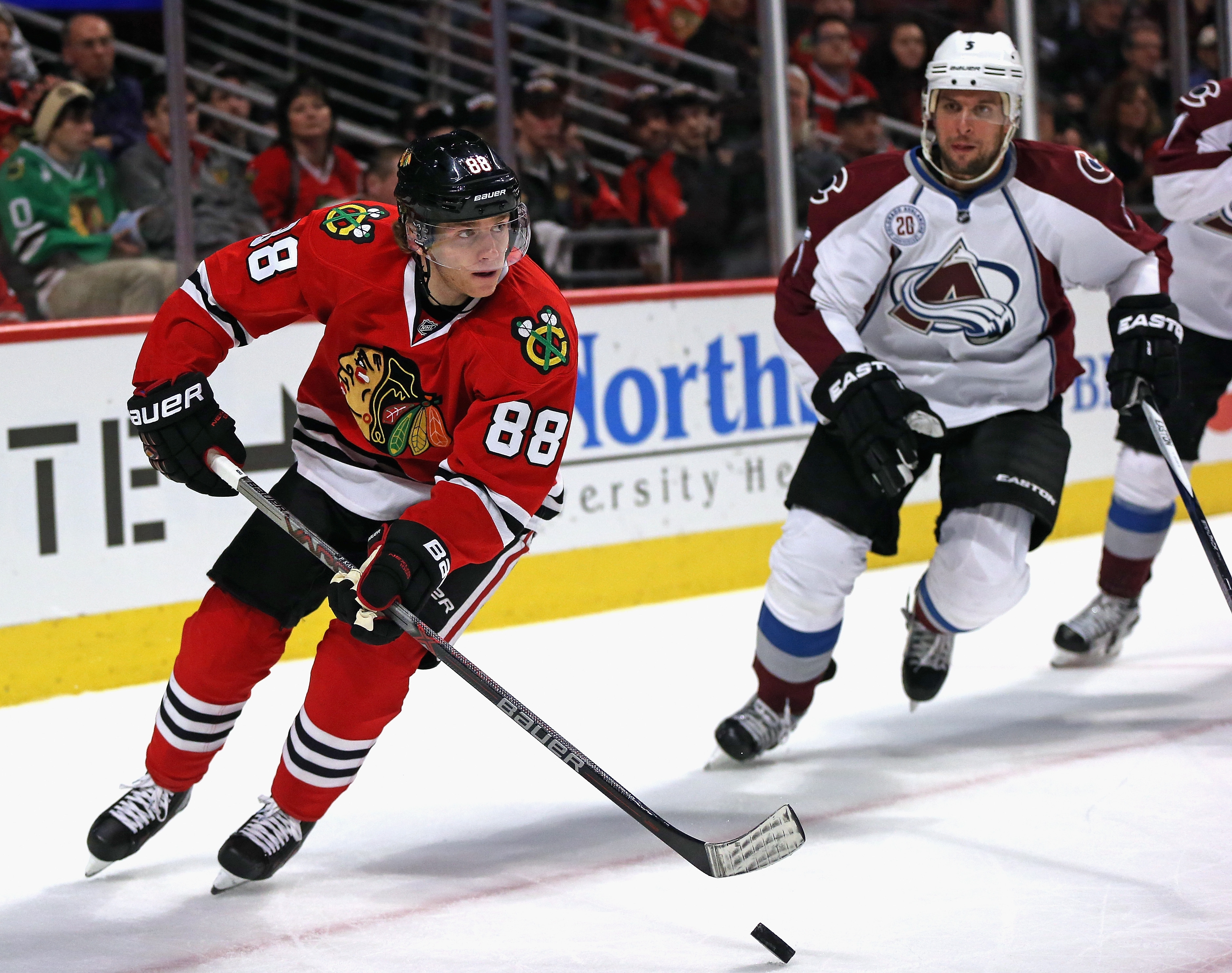 CHICAGO, IL - DECEMBER 15:  Patrick Kane #88 of the Chicago Blackhawks looks to pass as Nate Guenin #5 of the Colorado Avalanche closes in at the United Center on December 15, 2015 in Chicago, Illinois. The Avalanche defeated the Blackhawks 3-0.  (Photo by Jonathan Daniel/Getty Images)