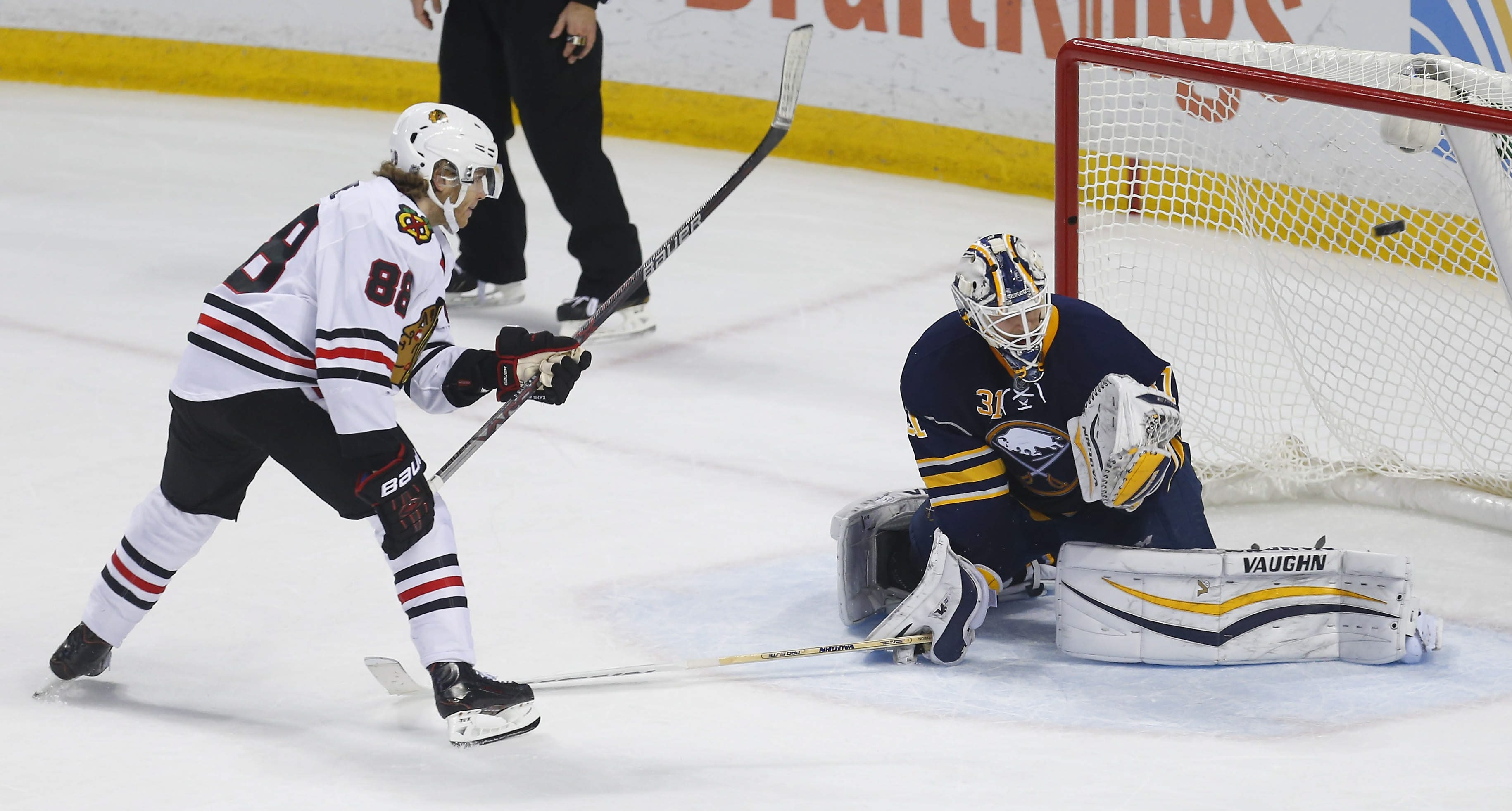 The Chicago Blackhawks' Patrick Kane lifts the puck over the Sabres' Chad Johnson for the lone shootout goal in Chicago's 3-2 victory at First Niagara Center Saturday.