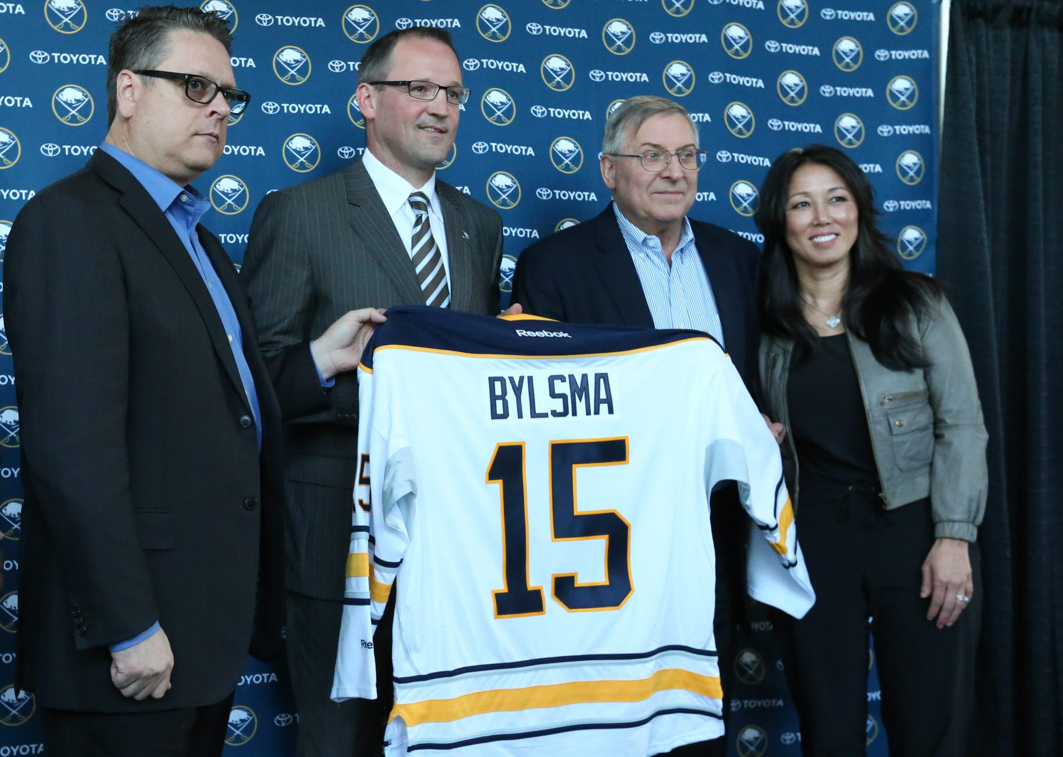 In happier times: Dan Bylsma gets his Sabres jersey from now ex-GM Tim Murray and owners Terry and Kim Pegula in May, 2015. (James P. McCoy/Buffalo News file photo)