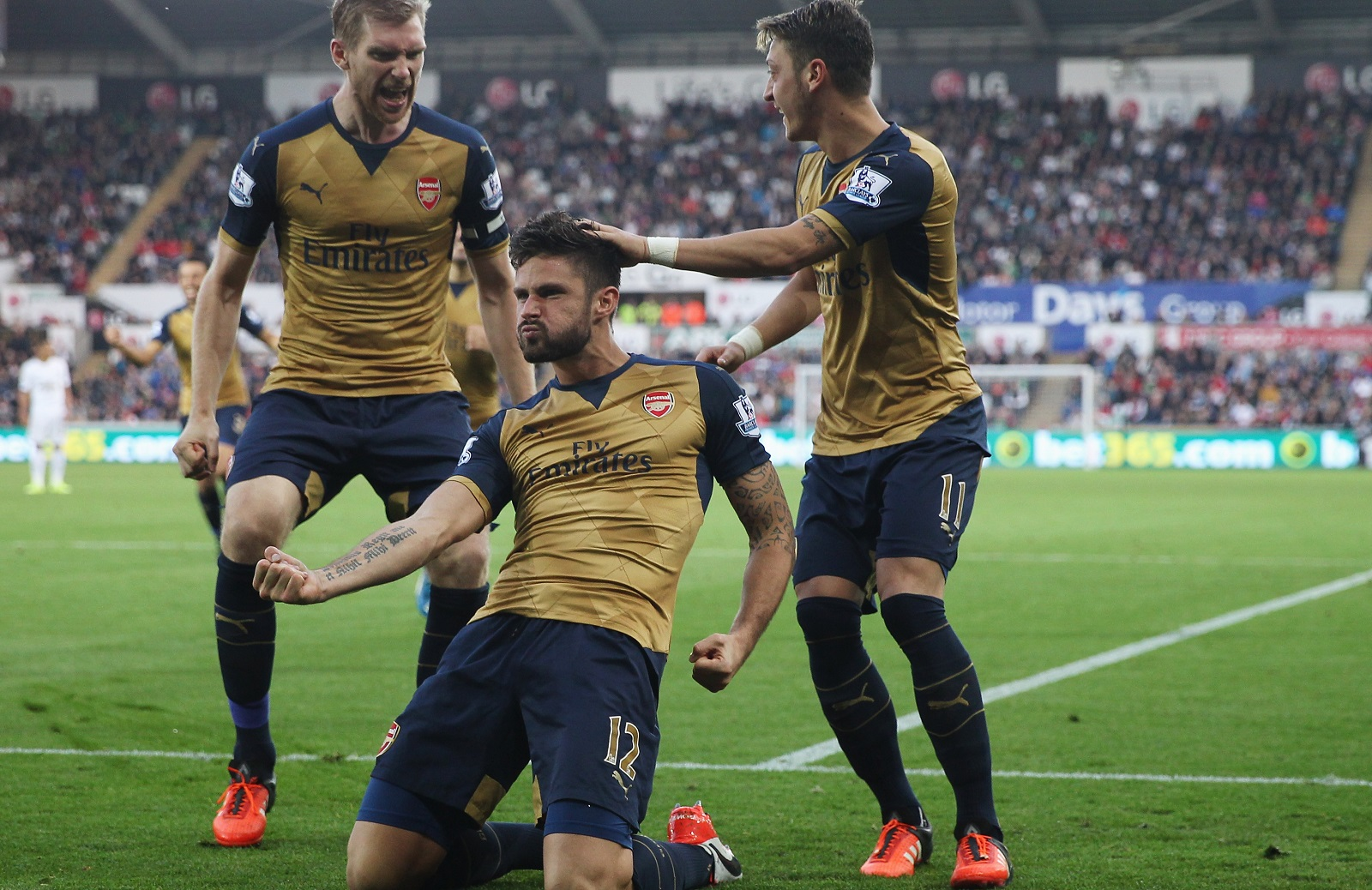 Olivier Giroud, middle, has been red-hot of late for Arsenal. (Getty Images)