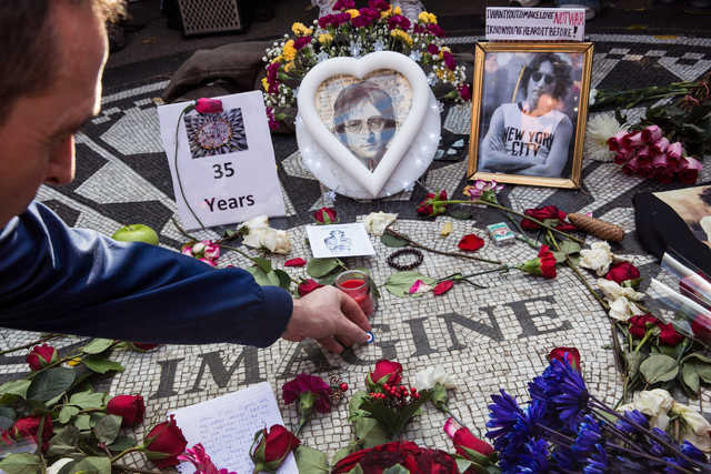 Fans gathered Tuesday to remember John Lennon, 35 years after his death. (Getty Images)