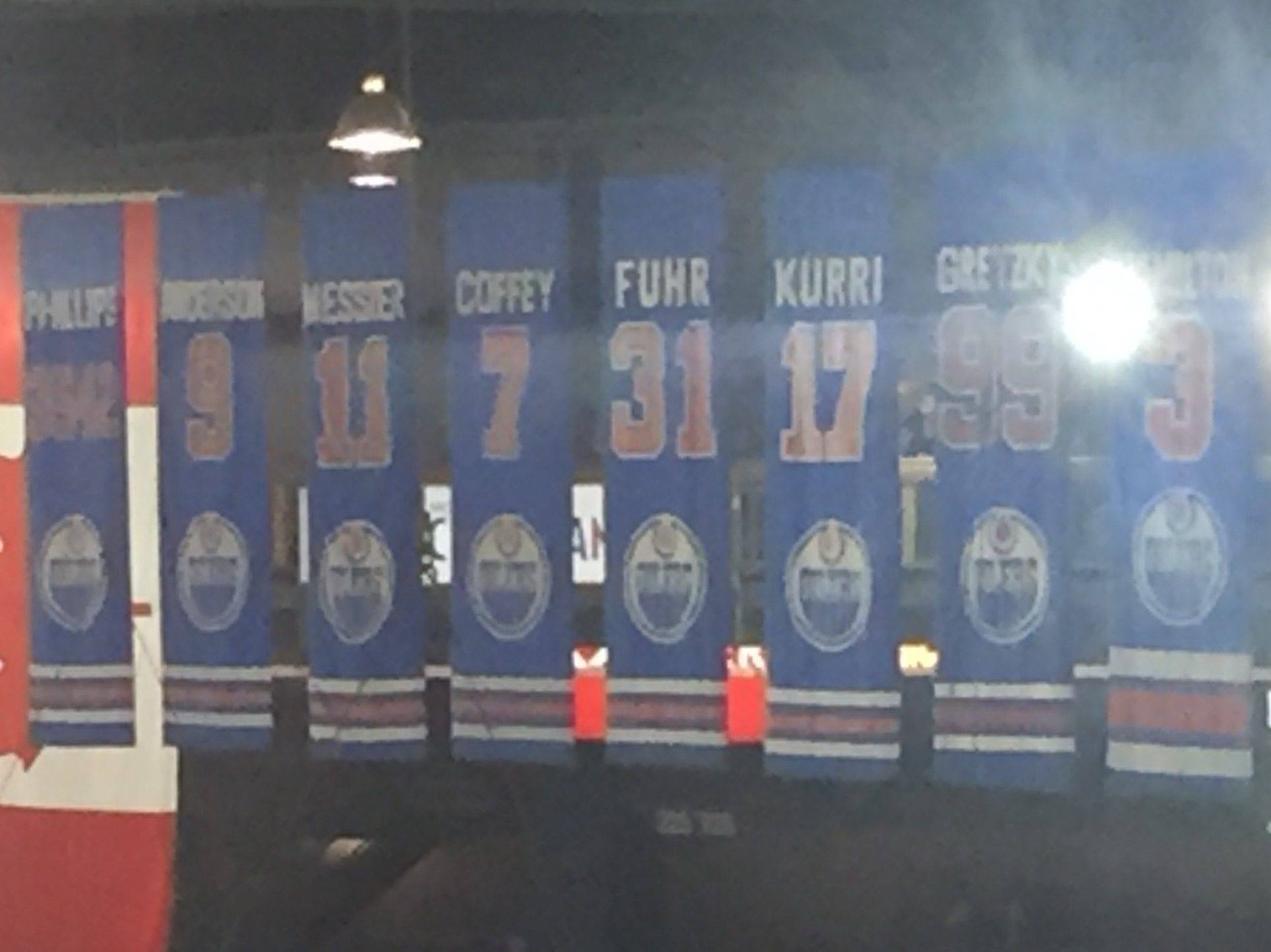 Edmonton's retired numbers for broadcaster Rod Phillips, Anderson, Messier, Coffey, Fuhr, Kurri, Gretzky and Al Hamilton. (Mike Harrington/Buffalo News).