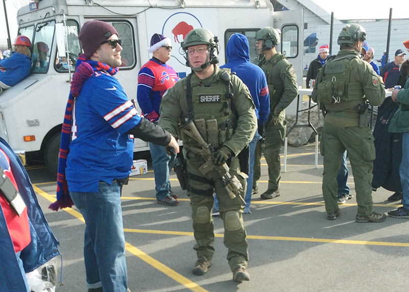 In light of the terror attacks in France, security is heavily armed outside NFL stadiums.