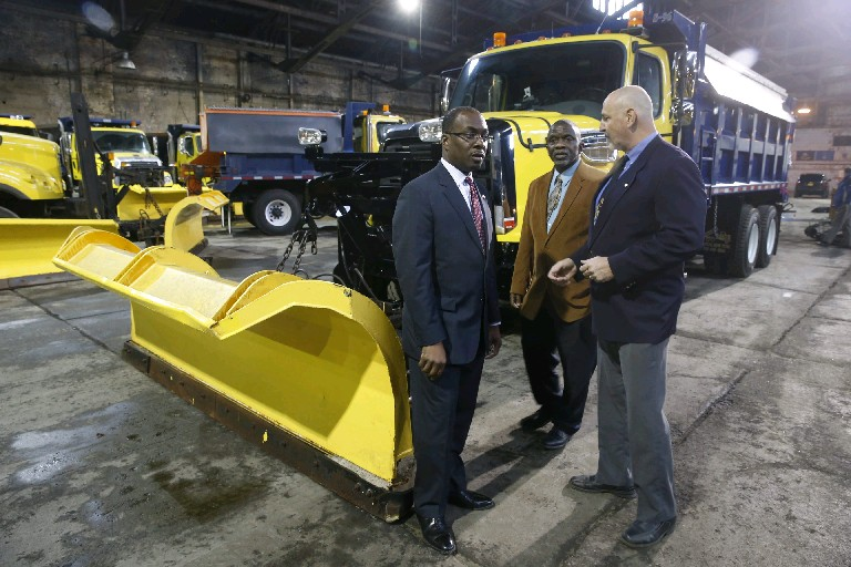 From left, Buffalo Mayor Byron Brown, Deputy Commissioner Henry Jackson and Commissioner Steven Stepniak take inventory pertaining to preparedness of snow removal at a press conference at the city barn on Broadway in Buffalo Tuesday. There's no snow in sight over the next week, but lessons learned from the past, namely 2001, prove that preparation isn't wasted time. (Robert Kirkham/Buffalo News)