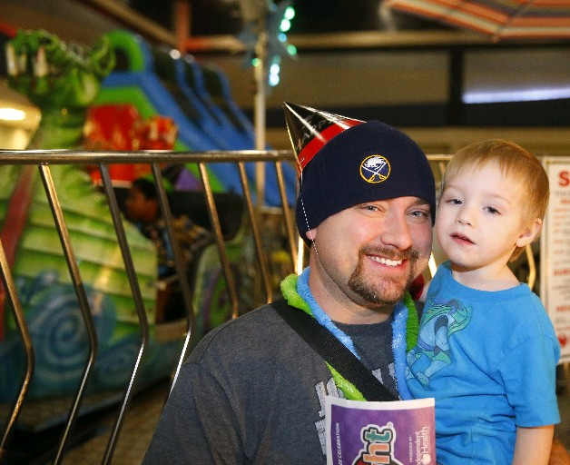 Robert Pijanowski and his son Peyton, 2, were among those who enjoyed First Night activities last New Year's Eve at the Convention Center in downtown Buffalo. (John Hickey/Buffalo News)