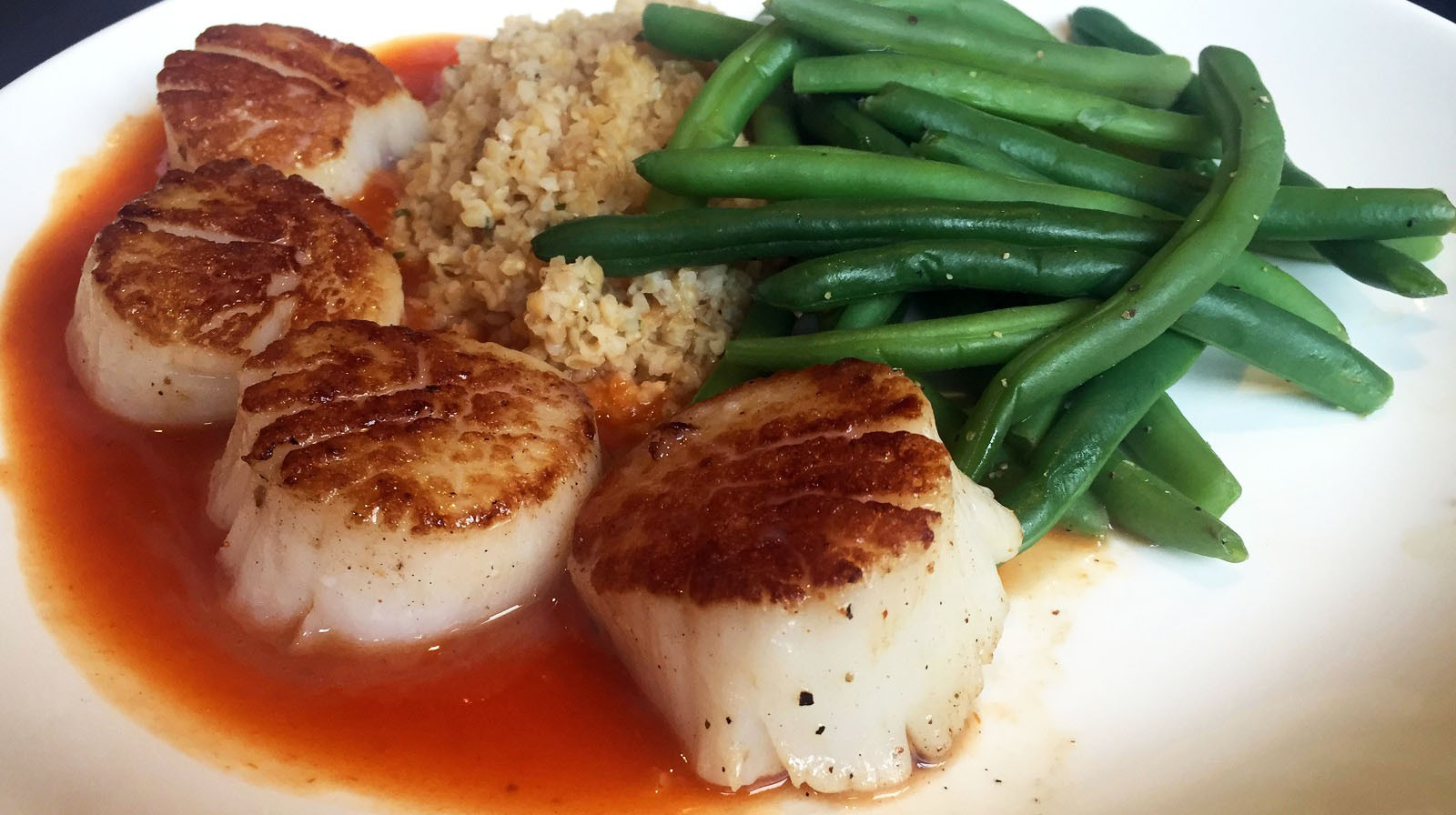 Seared scallops, an entree from The Pub by Wegmans, run for $24 and include green beans and bulgur wheat salad. (Lizz Schumer/Special to The News)
