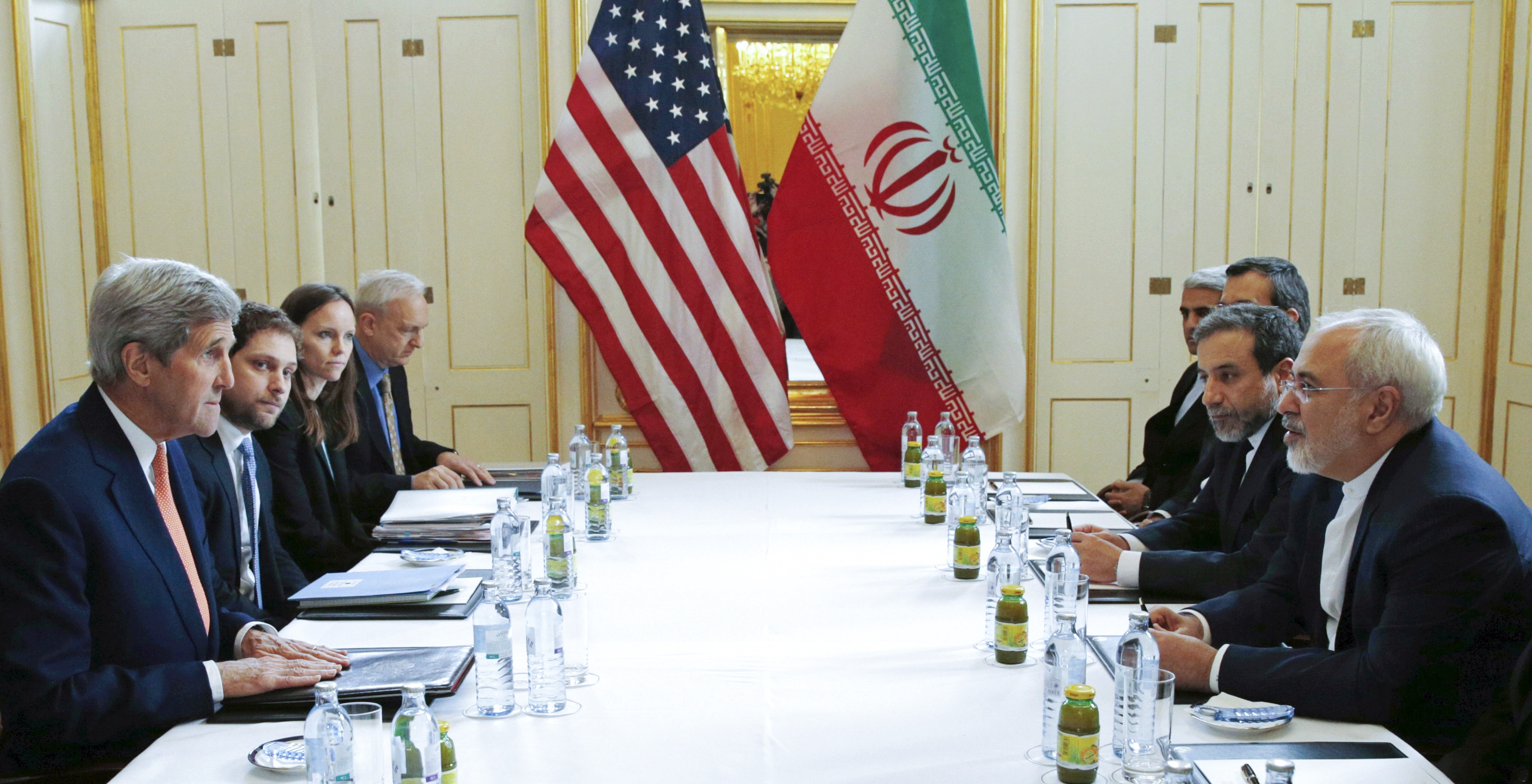 Secretary of State John Kerry, left, and Iran Foreign Minister Javad Zarif, right, worked out the final details of the nuclear accord Saturday in Vienna. (New York Times photo)
