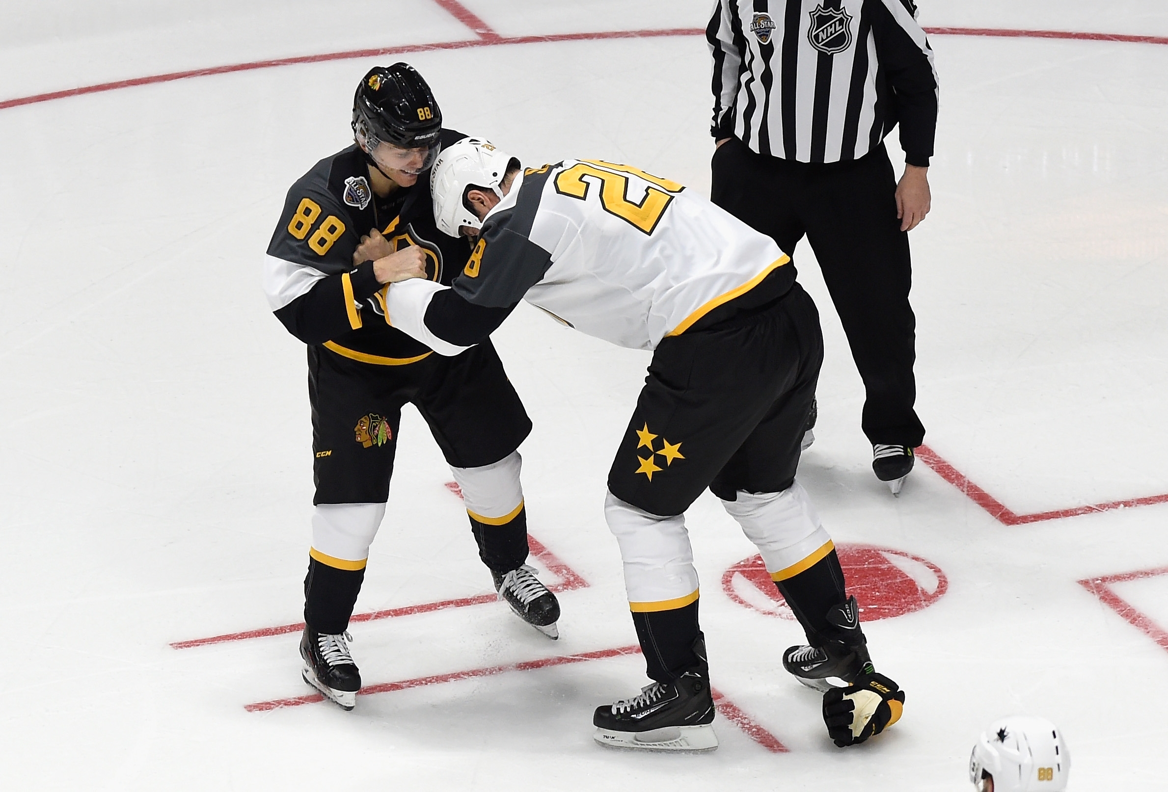 John Scott and Patrick Kane jokingly square off after Scott hit Kane during the All-Star Game in Nashville.
