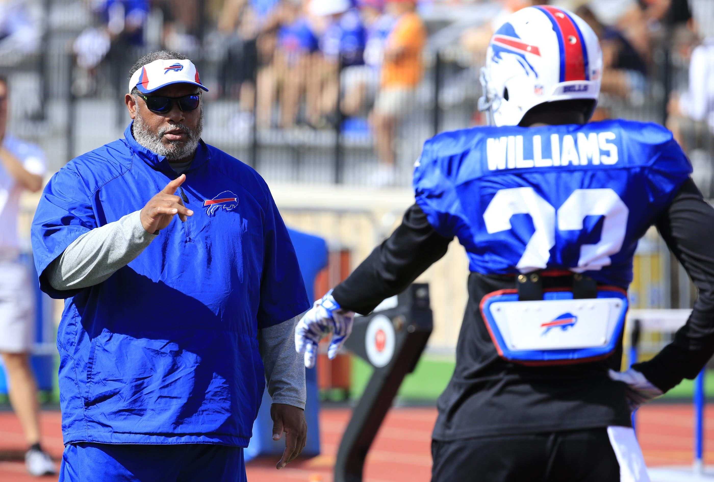 Buffalo Bills defensive back coach Donnie Henderson works with Aaron Williams during Bills training camp.
