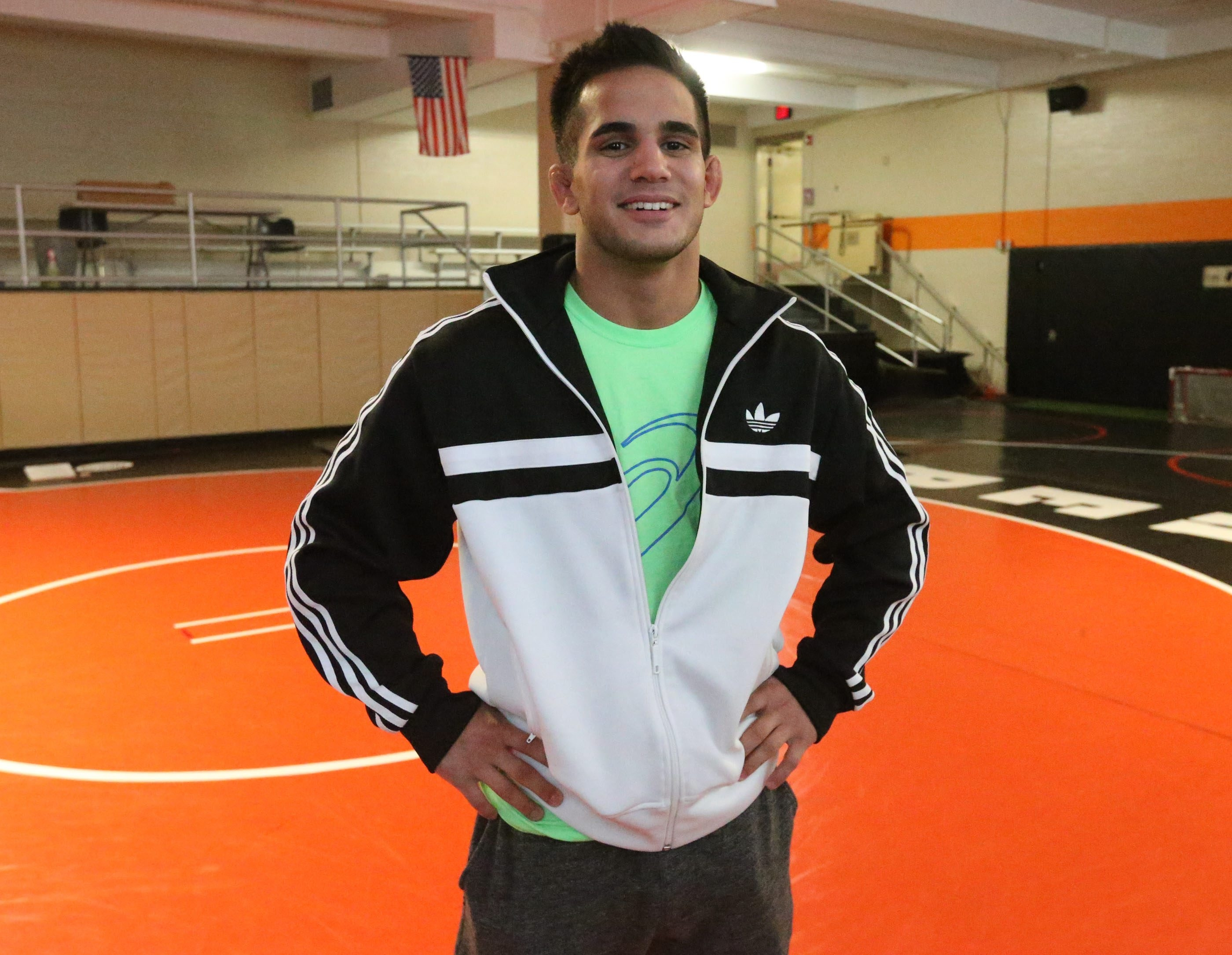 State and national champion Kellen Devlin of Amherst leads a once-a-week-practice session featuring the area's top wrestling talents in hopes of helping them turn their state-title dreams into reality.