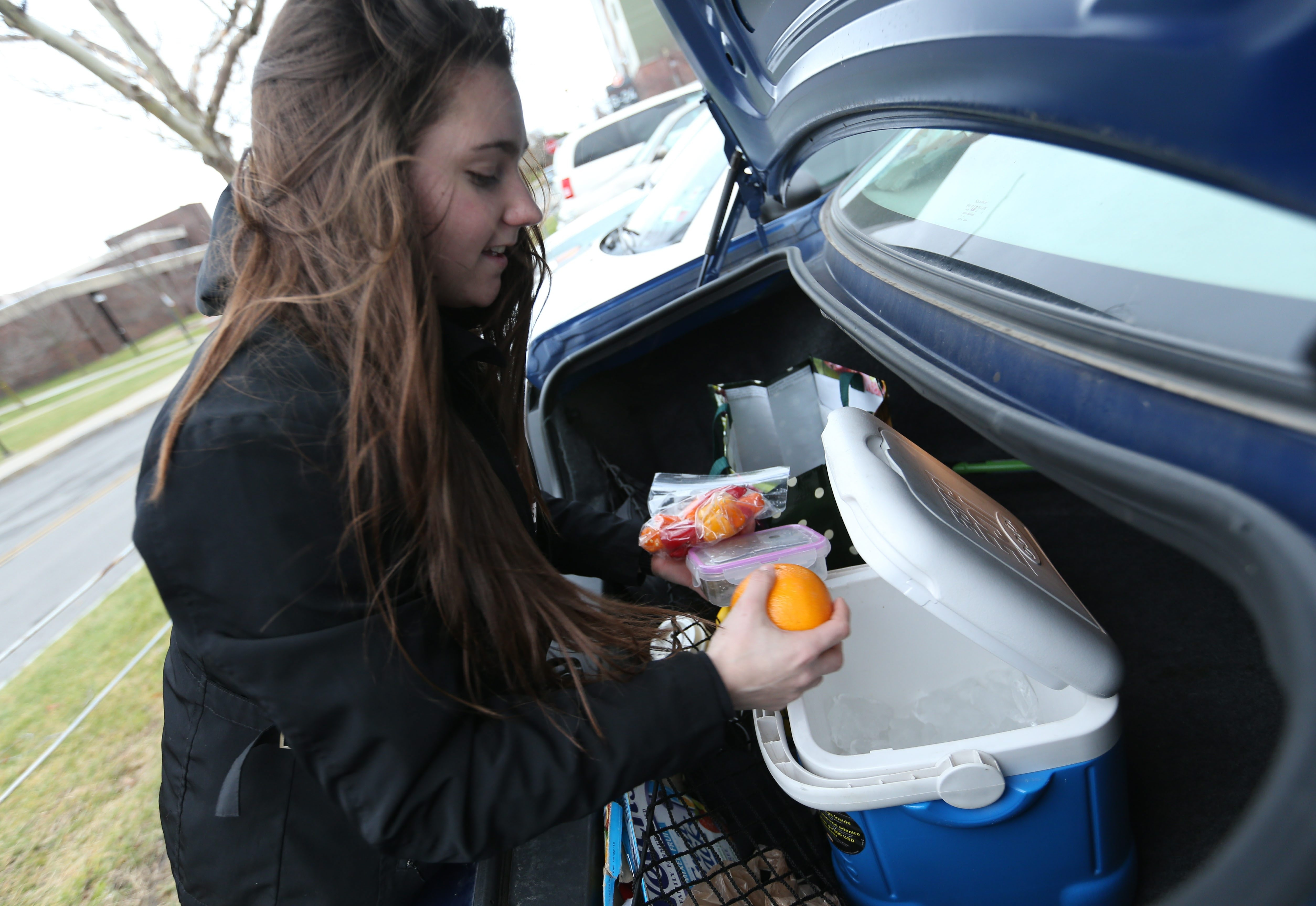 Buffalo State sophomore Charissa Szpaicher, who commutes from Wheatfield, keeps a cooler in her car filled with a healthful lunch and snacks. (Sharon Cantillon/Buffalo News)