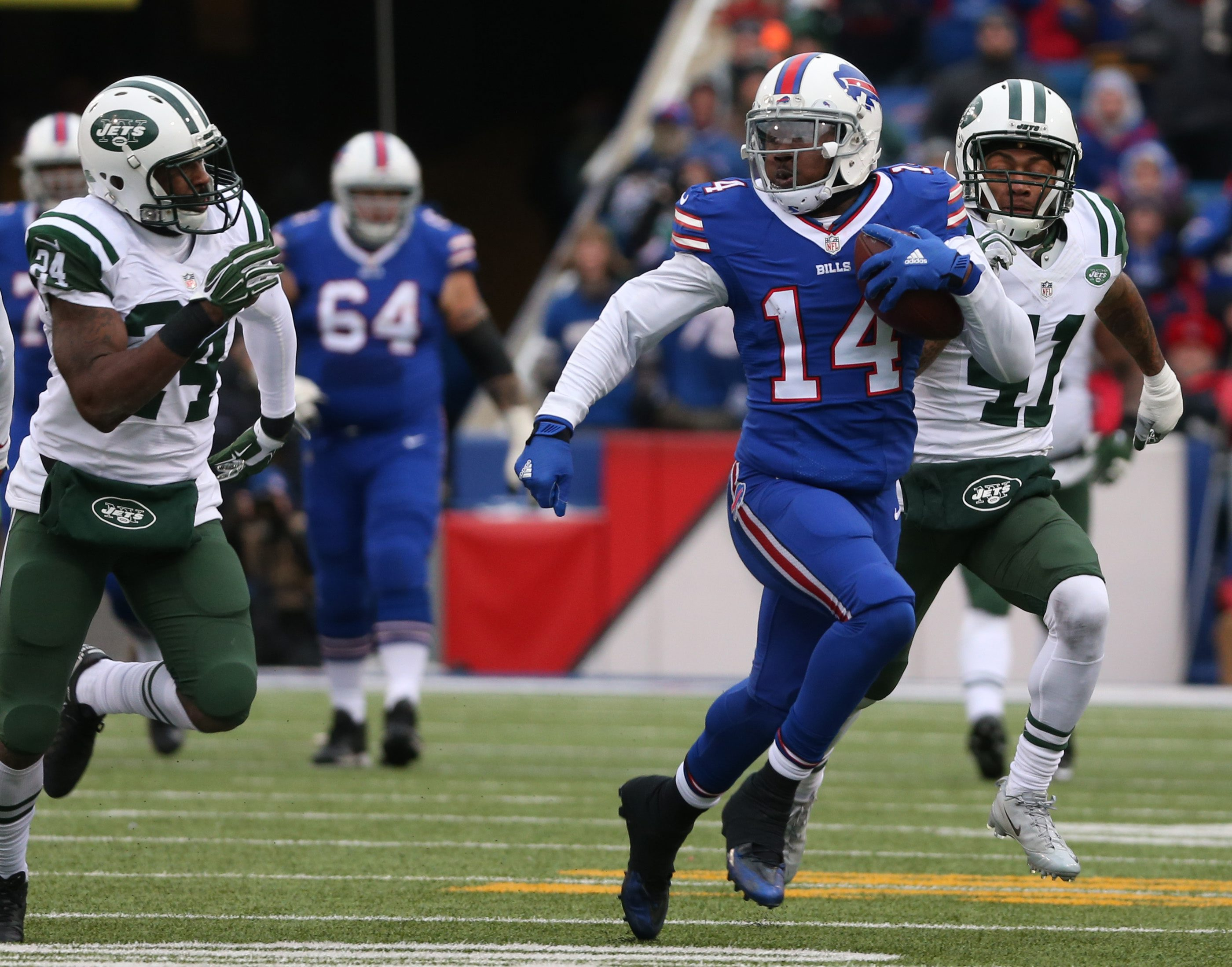Buffalo Bills wide receiver Sammy Watkins (14) makes a great one-handed catch in front of New York Jets free safety Marcus Gilchrist (21) for a first down in the third quarter Sunday.  (James P. McCoy/ Buffalo News)