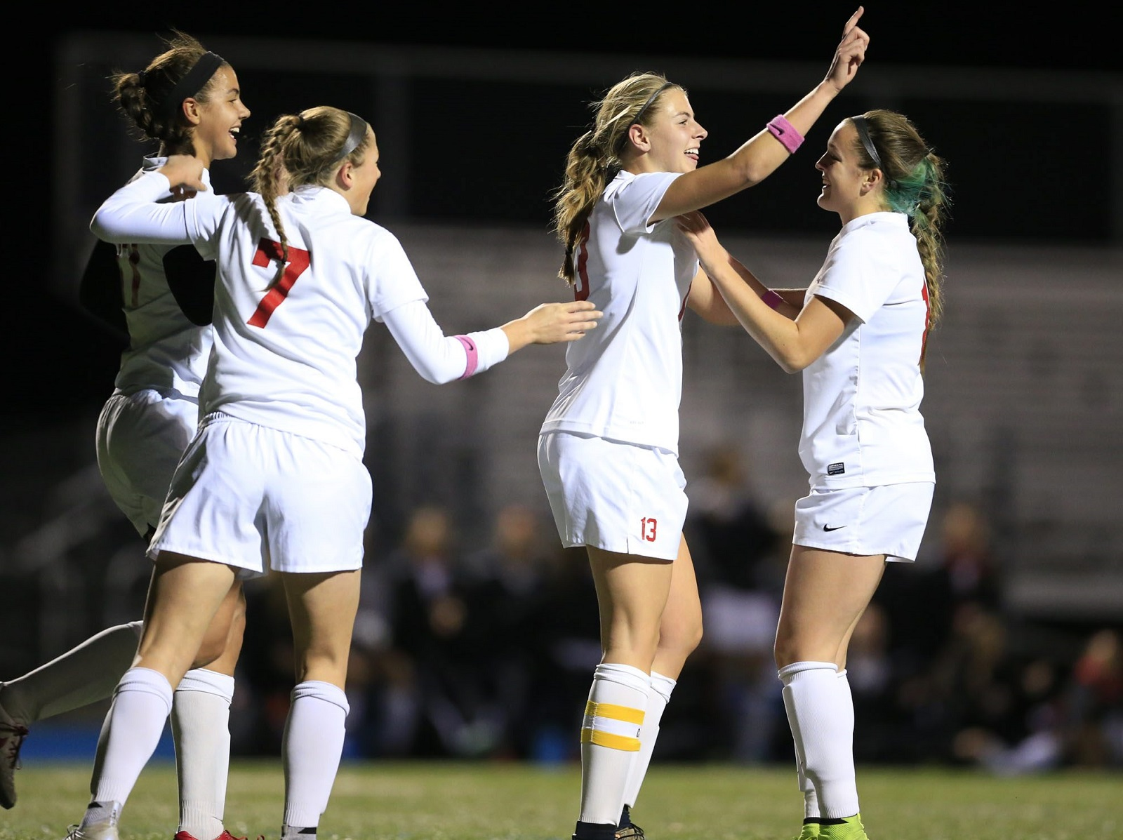 Sydney Cerza, second from right, celebrates her second goal against Niagara Wheatfield. She'll head to St. Bonaventure to play soccer. (Harry Scull Jr./Buffalo News file photo)
