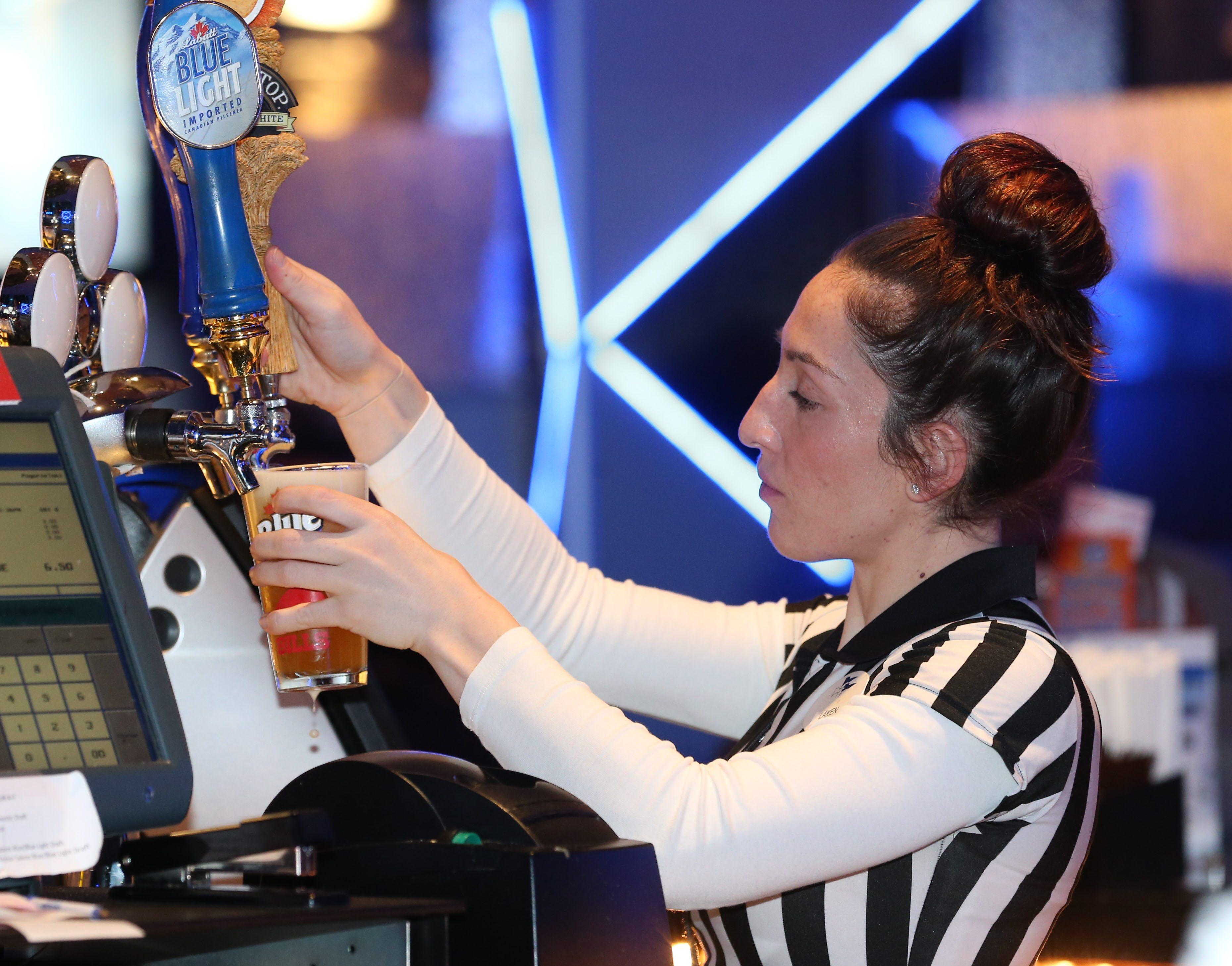Bartender Laken Pogorzelski pours a Shock Top at the Cyclone inside Hamburg Gaming. (Sharon Cantillon/Buffalo News)
