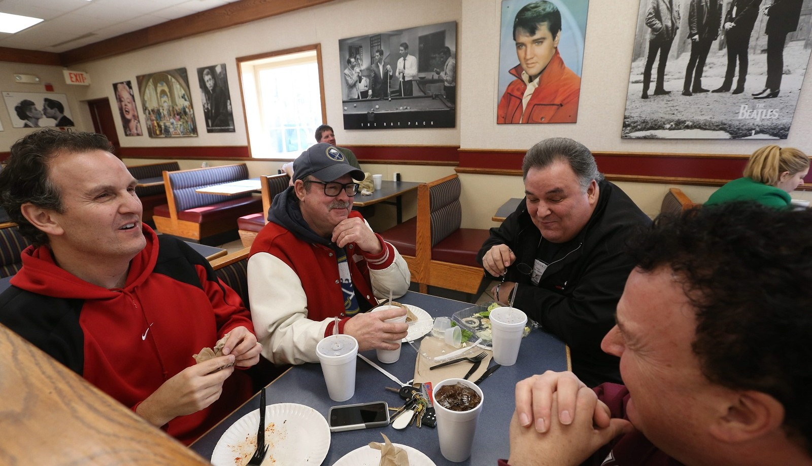 Having lunch at LT's Olde Tyme Pizza, from left, are regular customers Alan Overhoff, Sonny Hari, Alan's brother Dean Overhoff, and other brother Mark Overhoff.  (Sharon Cantillon/Buffalo News)