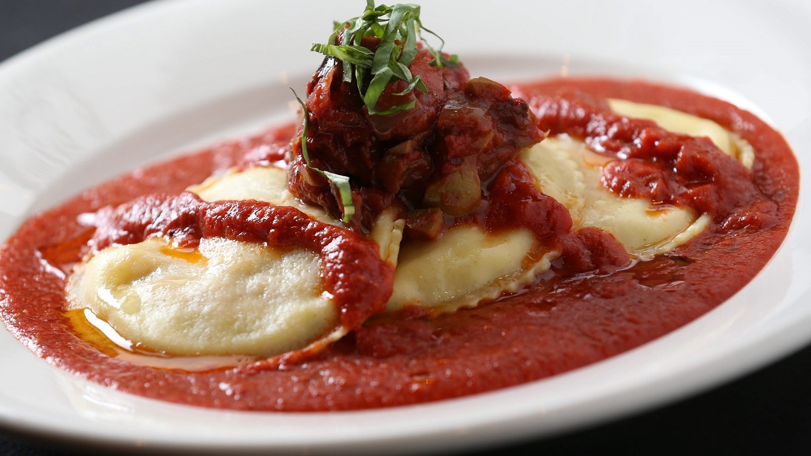 Osteria 166's tomato-eggplant ravioli is one of Andrew Galarneau's choices for great housemade pasta. (Sharon Cantillon/Buffalo News)