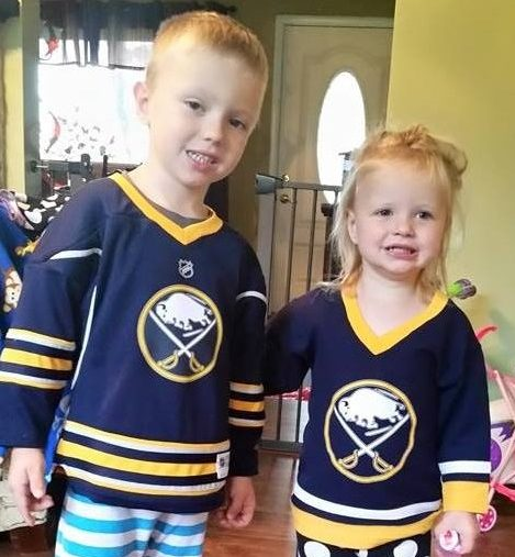 Gavin, 5, and Lillian, 3, hang out in their Sabres jerseys.