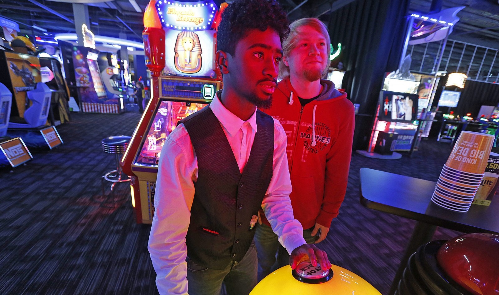 Spend Super Bowl Sunday at Dave & Buster's in the Walden Galleria where you can play games, have a drink and grab some food. College buddies Jajuan Reeves, front and Dalton Robinson, are pictured playing a reflex challenging game. (Robert Kirkham/Buffalo News file photo)
