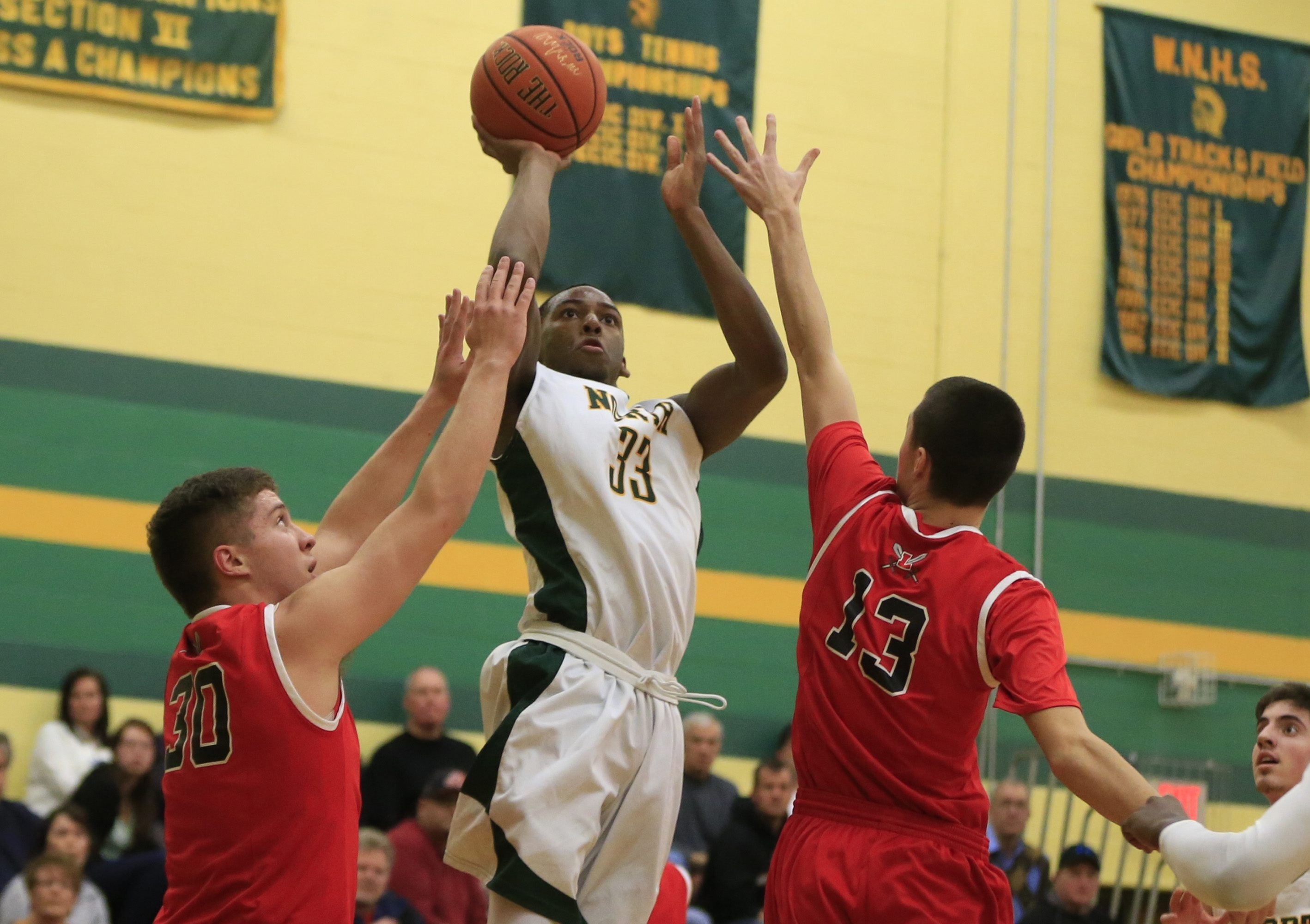 Williamsville North's Maceo Jack shoots against Lancaster during first-half action of their game won by the Spartans, 66-39.