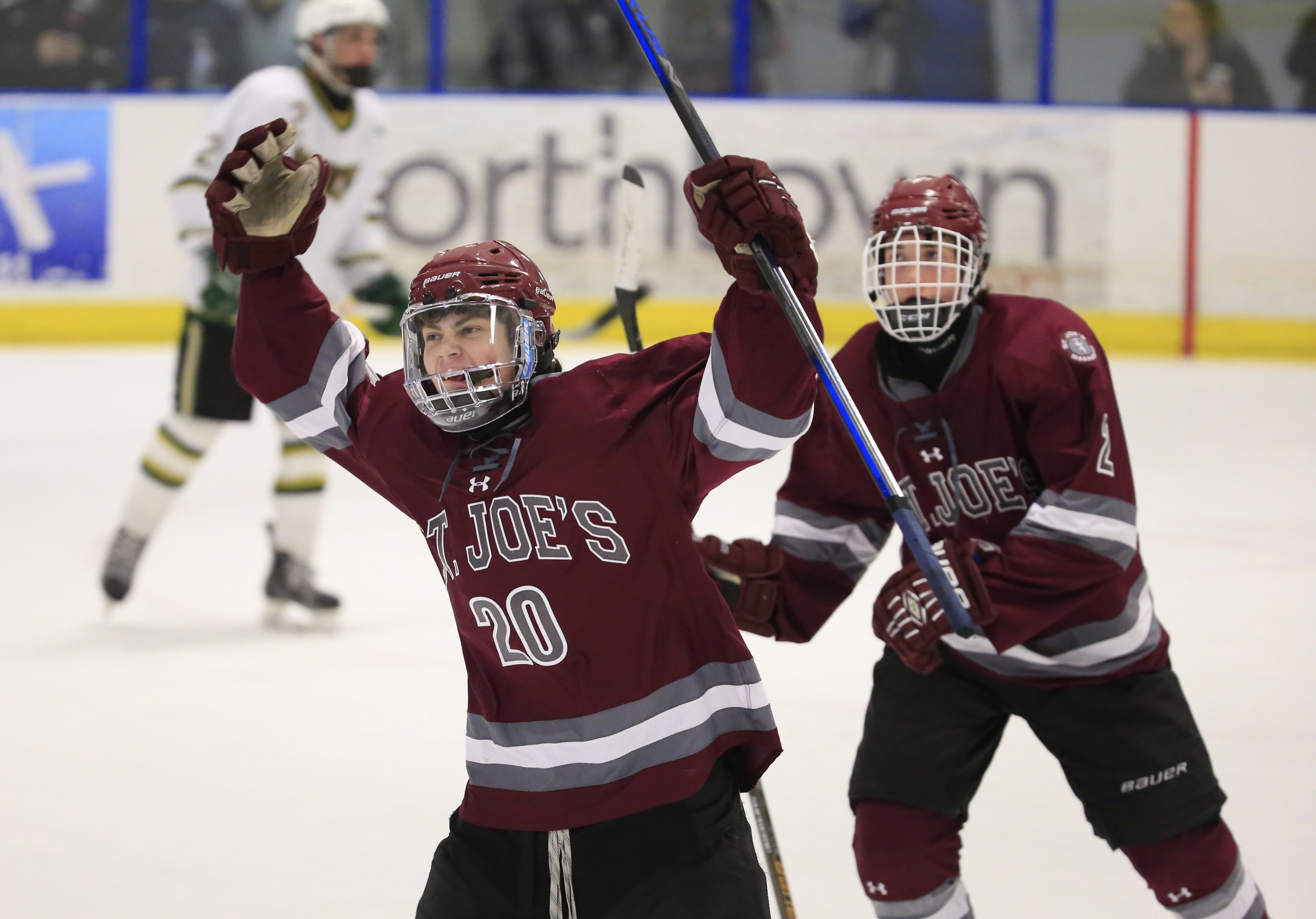 Erich Thur celebrates with teammates from St. Joe's after he scored against Williamsville North during action at the Northtown Center on Thursday.