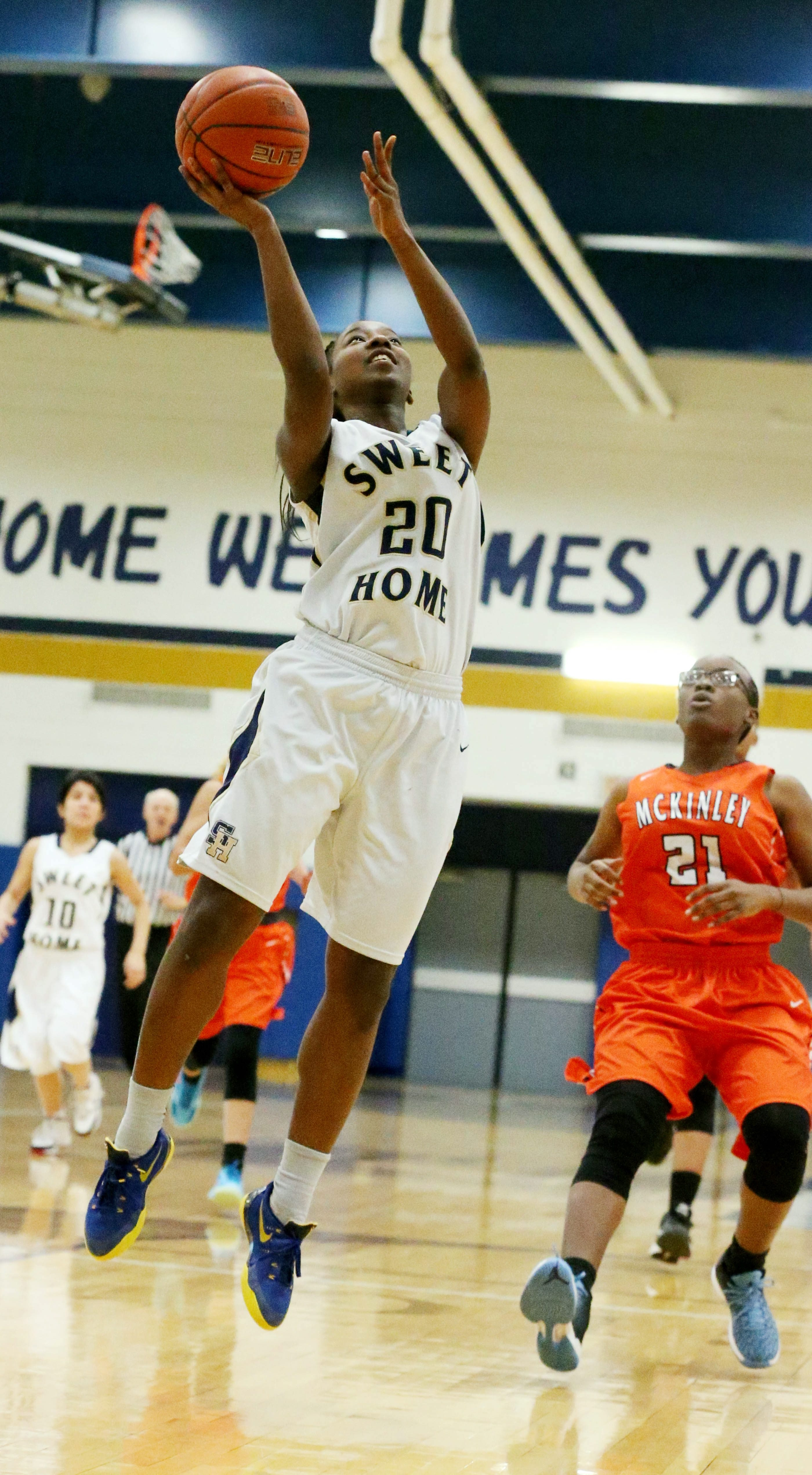 Sweet Home's Neraelyn Trueheart scores two points against McKinley during the Panthers' 50-28 victory in Class A-1.