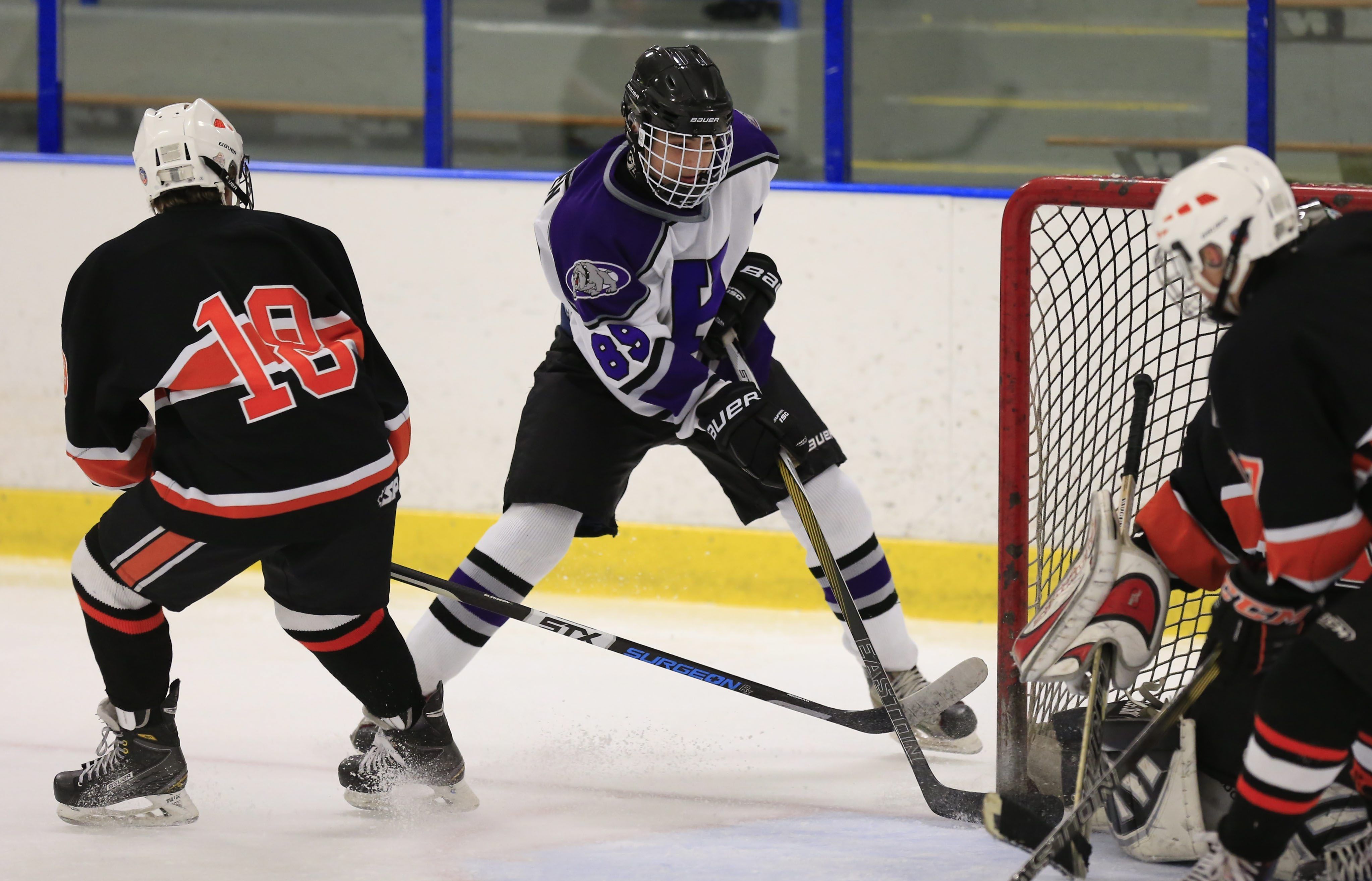 Hamburg's Jacob Hangen, center, scores against Amherst during second period playoff action at the Northtown Center on Thursday.