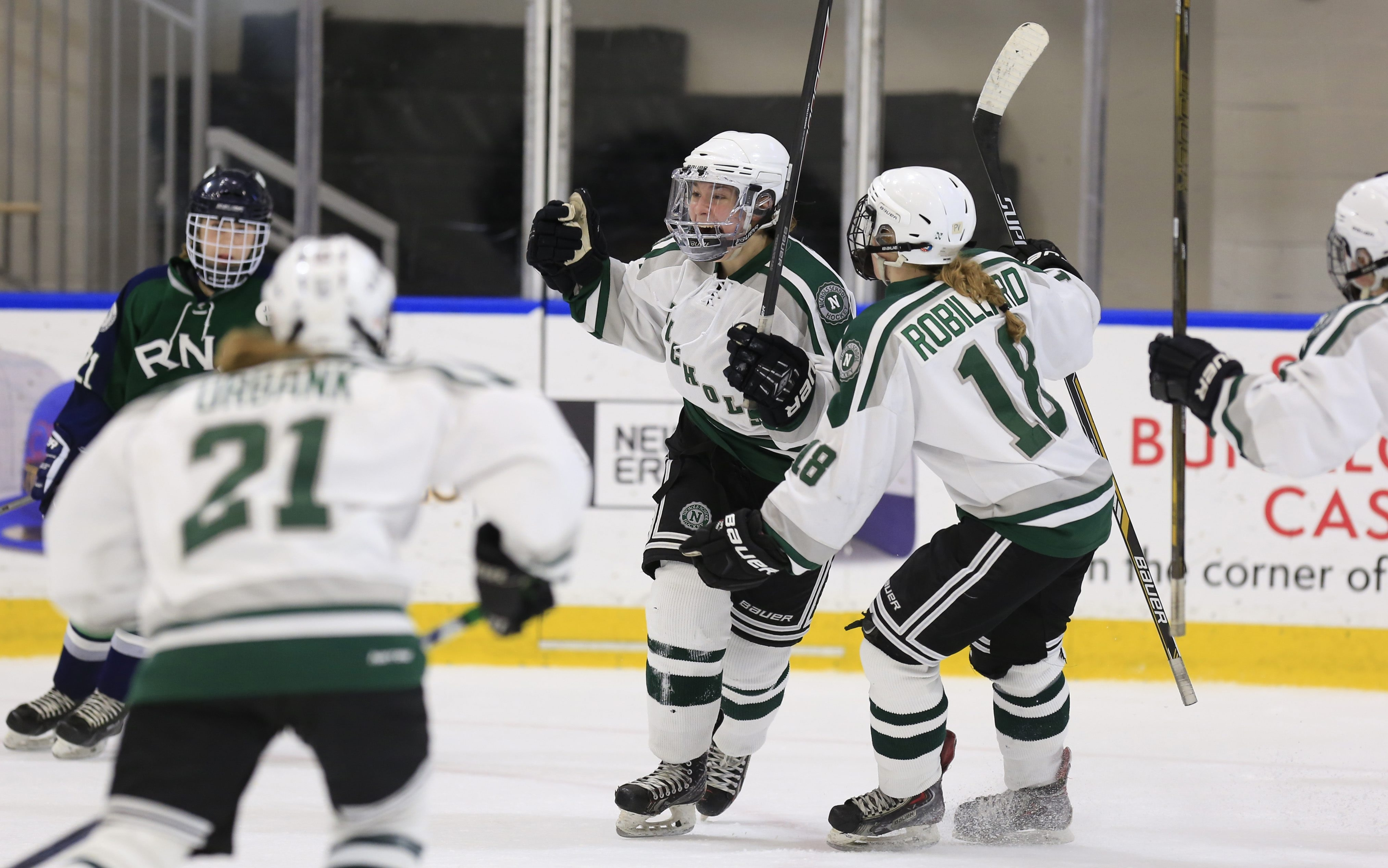 Katelyn Knoll of Nichols celebrates a second period goal against Rothesay Netherwood in a consolation game in the NAPHA Championships at HarborCenter on Saturday.