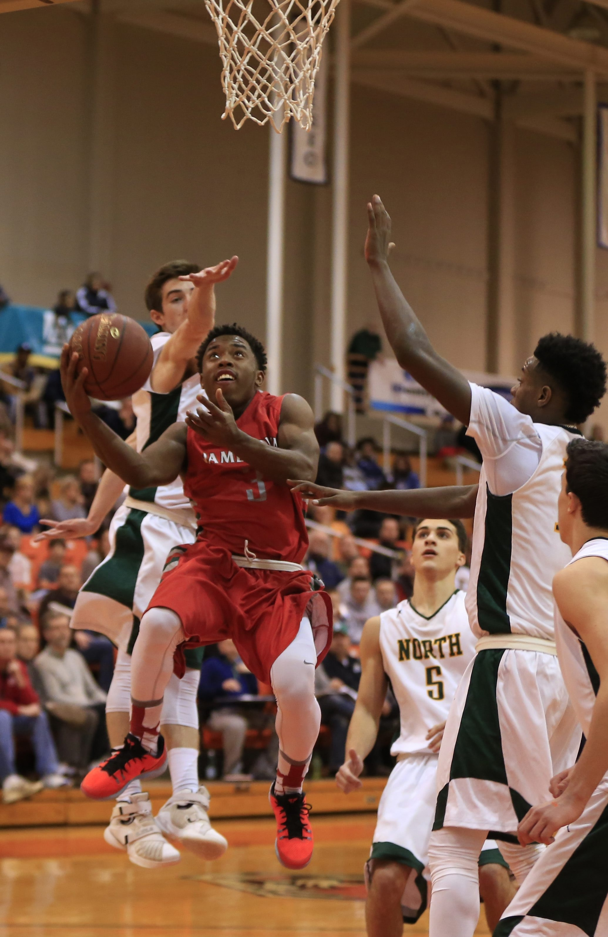 Jamestown's Zacc Kinsey drives to the basket against Williamsville North during the Red Raiders' 45-44 victory Tuesday.