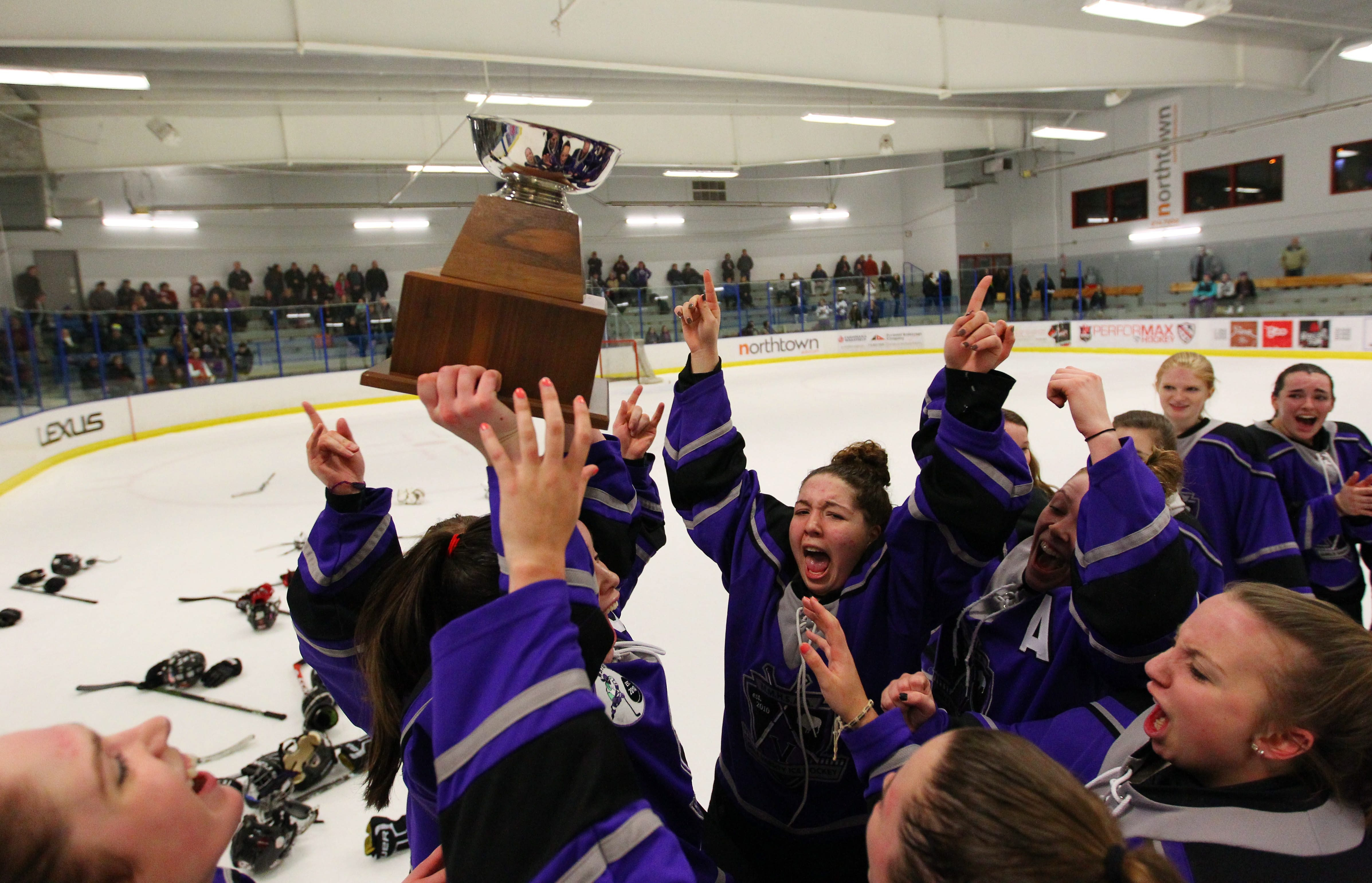 Monsignor Martin celebrates their 2-0 victory over Williamsville to earn their fourth federation hockey title in five years.
