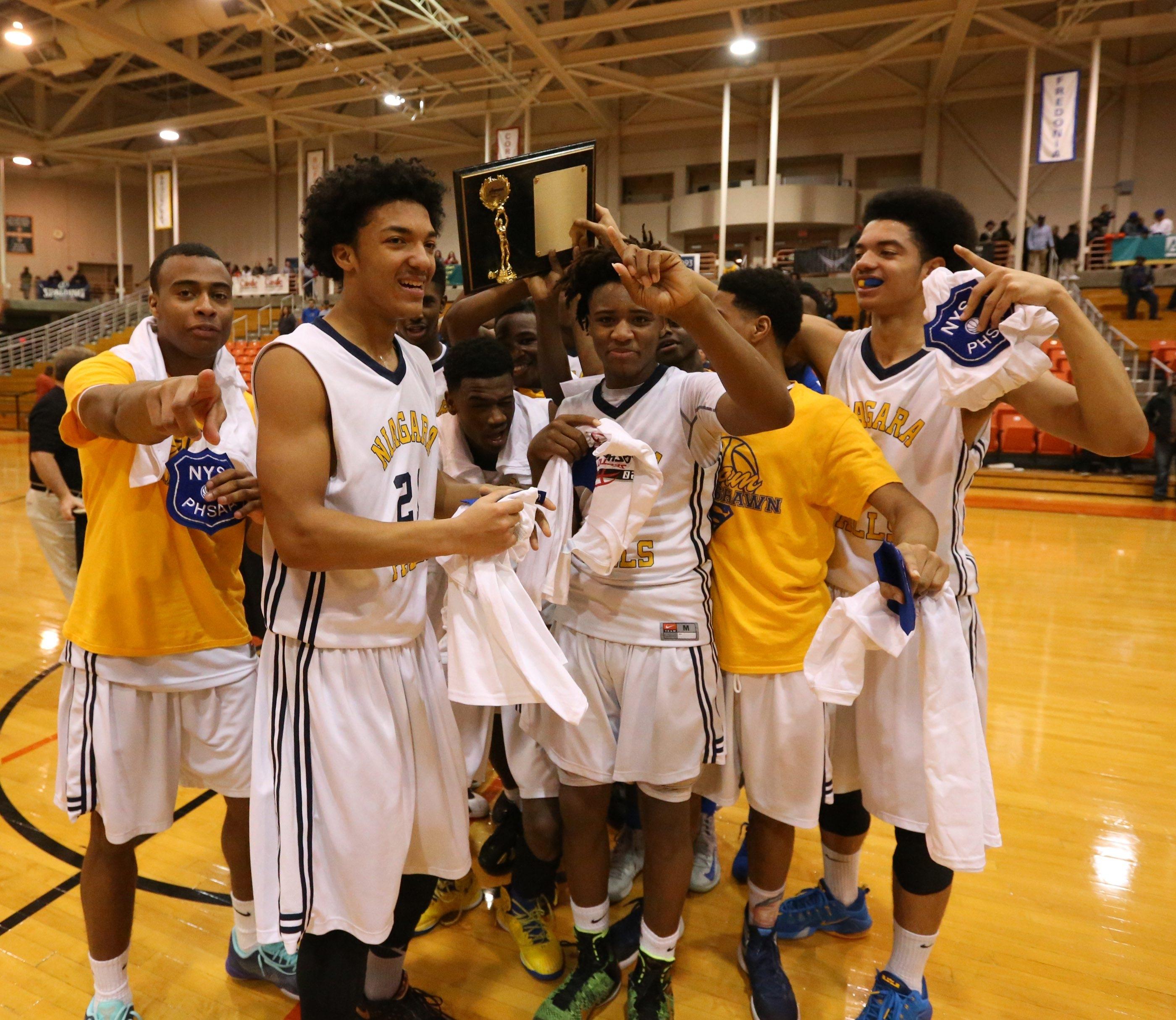 The Niagara Falls boys basketball team celebrates its 58-44 win over Jamestown Saturday night.