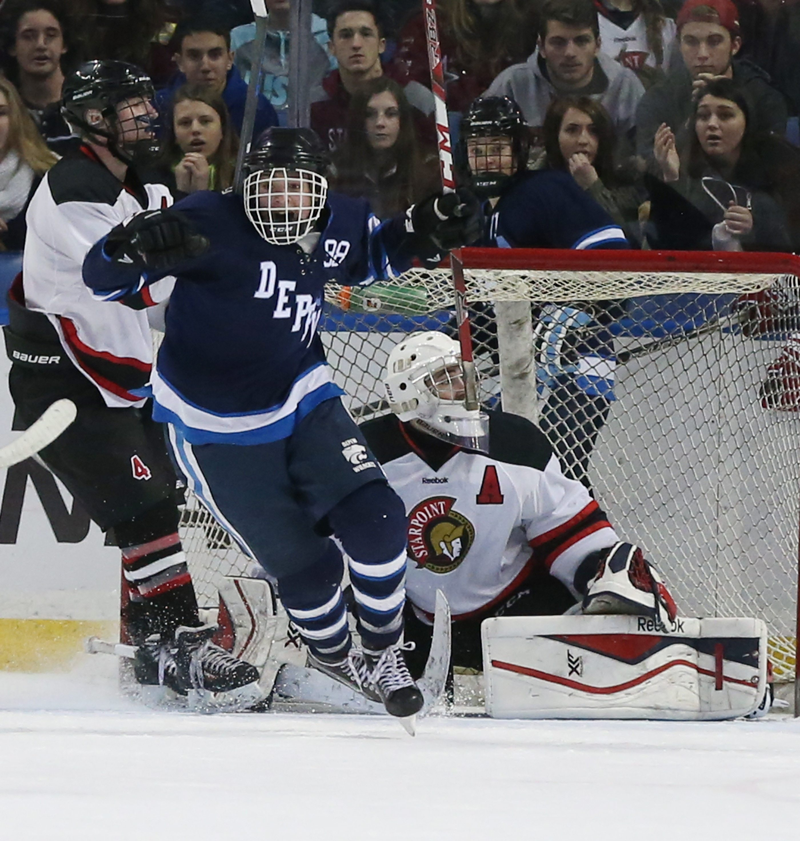 Depew's Nick Grupp scores the game winning goal in triple over time to beat Starpoint 3-2 for the Small school club hockey championship at First Niagara Center in Buffalo,NY on Sunday, Feb. 28, 2016.  (James P. McCoy/ Buffalo News)