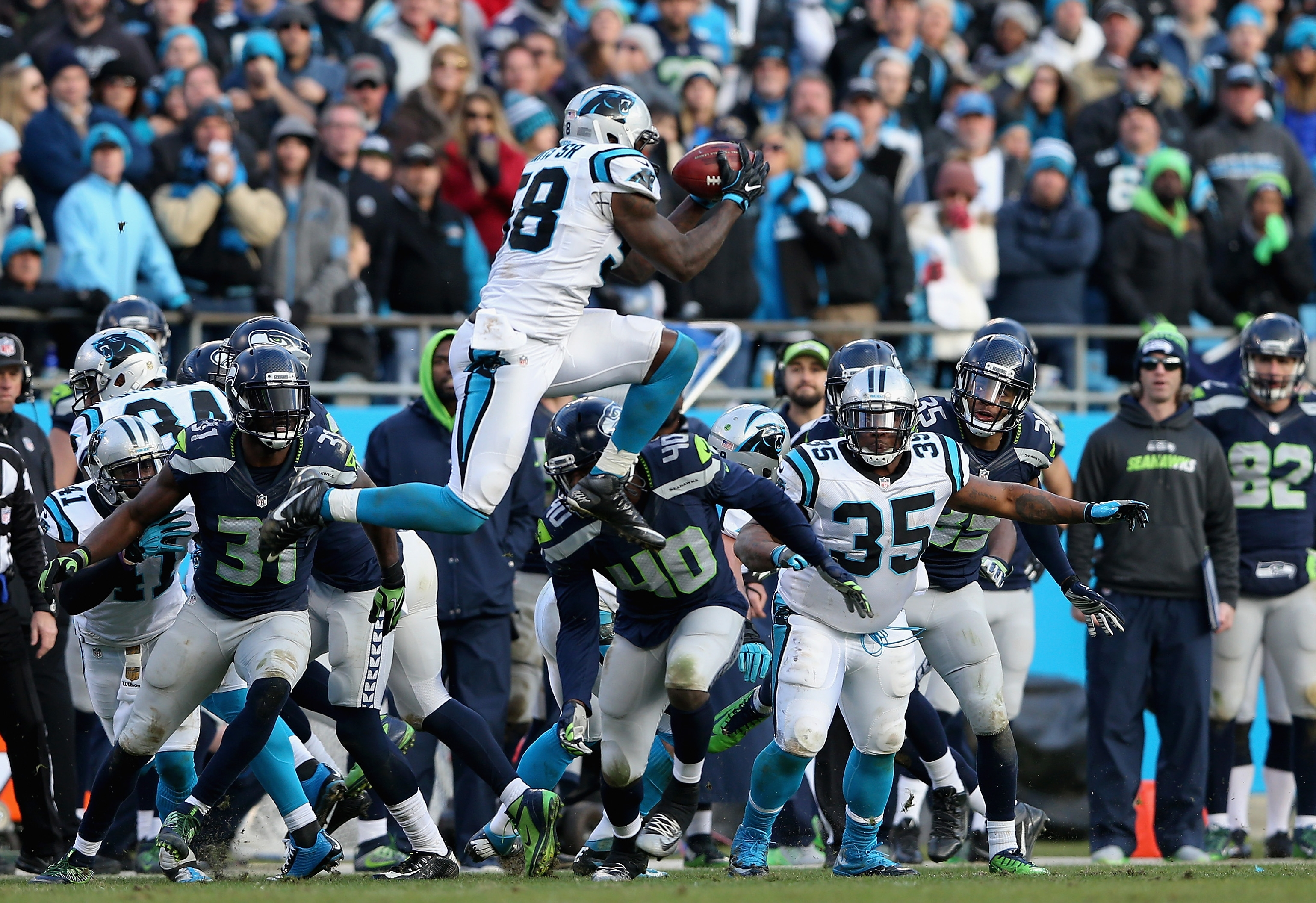 Thomas Davis, Carolina's inspirational leader, soars to corral an onside kick during the fourth quarter of the Panthers' NFC Divisional Playoff game against Seattle.