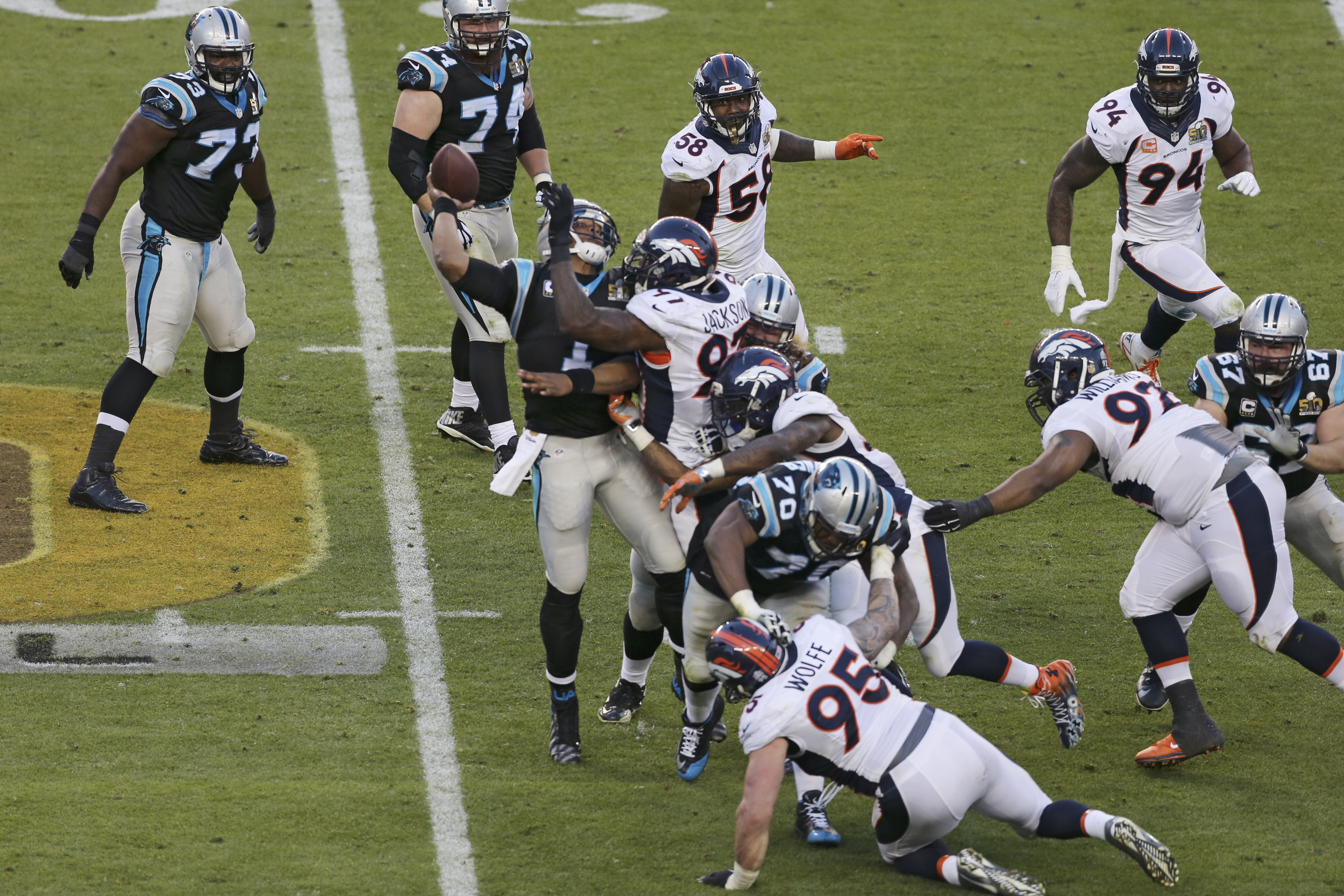 Carolina Panthers quarterback Cam Newton is swarmed by the Denver Broncos defense for one of six sacks for the game.