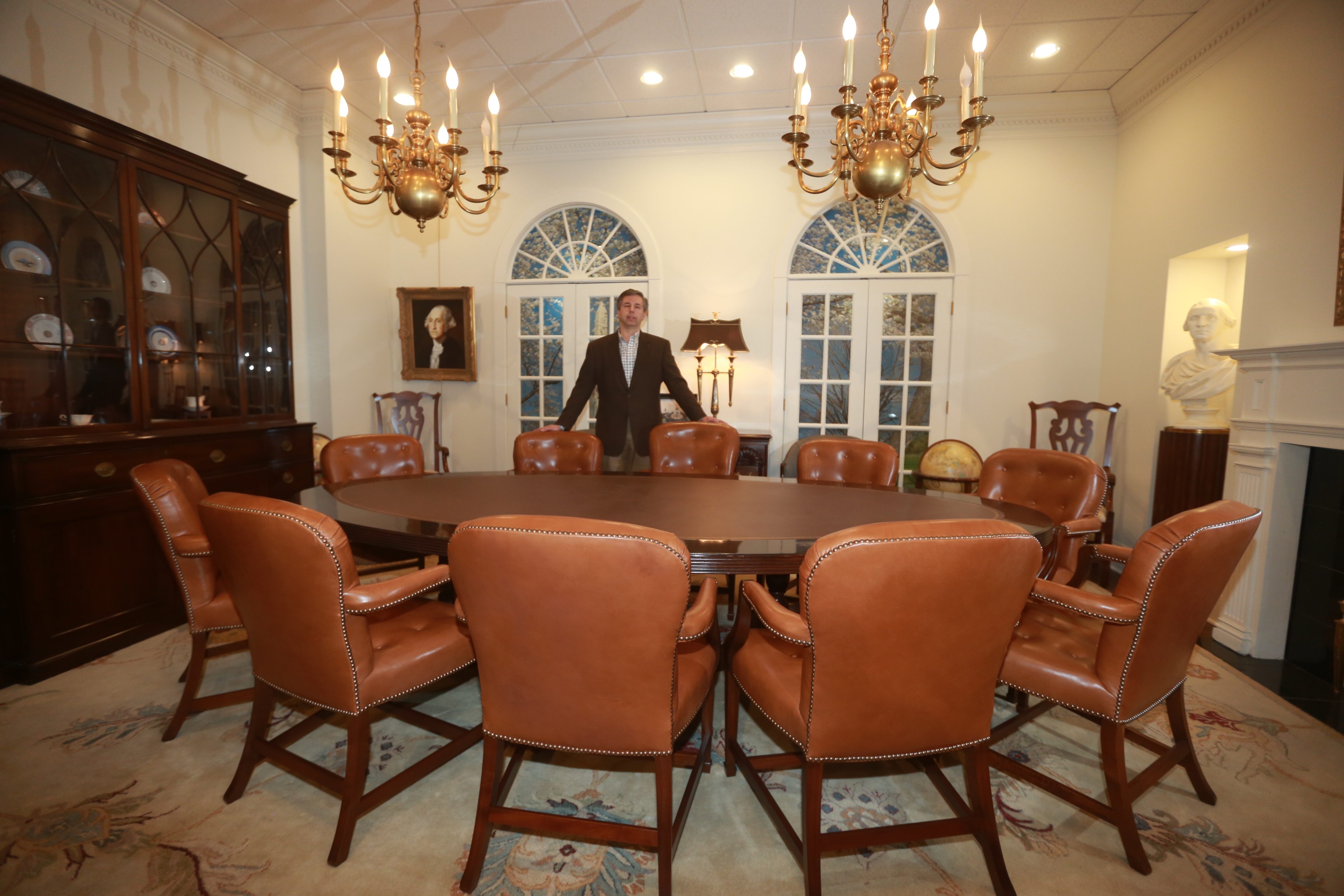 Raymond C. Bialkowski shows off the chairs Kittinger Furniture Co.  manufactured for the Roosevelt Room of the White House.