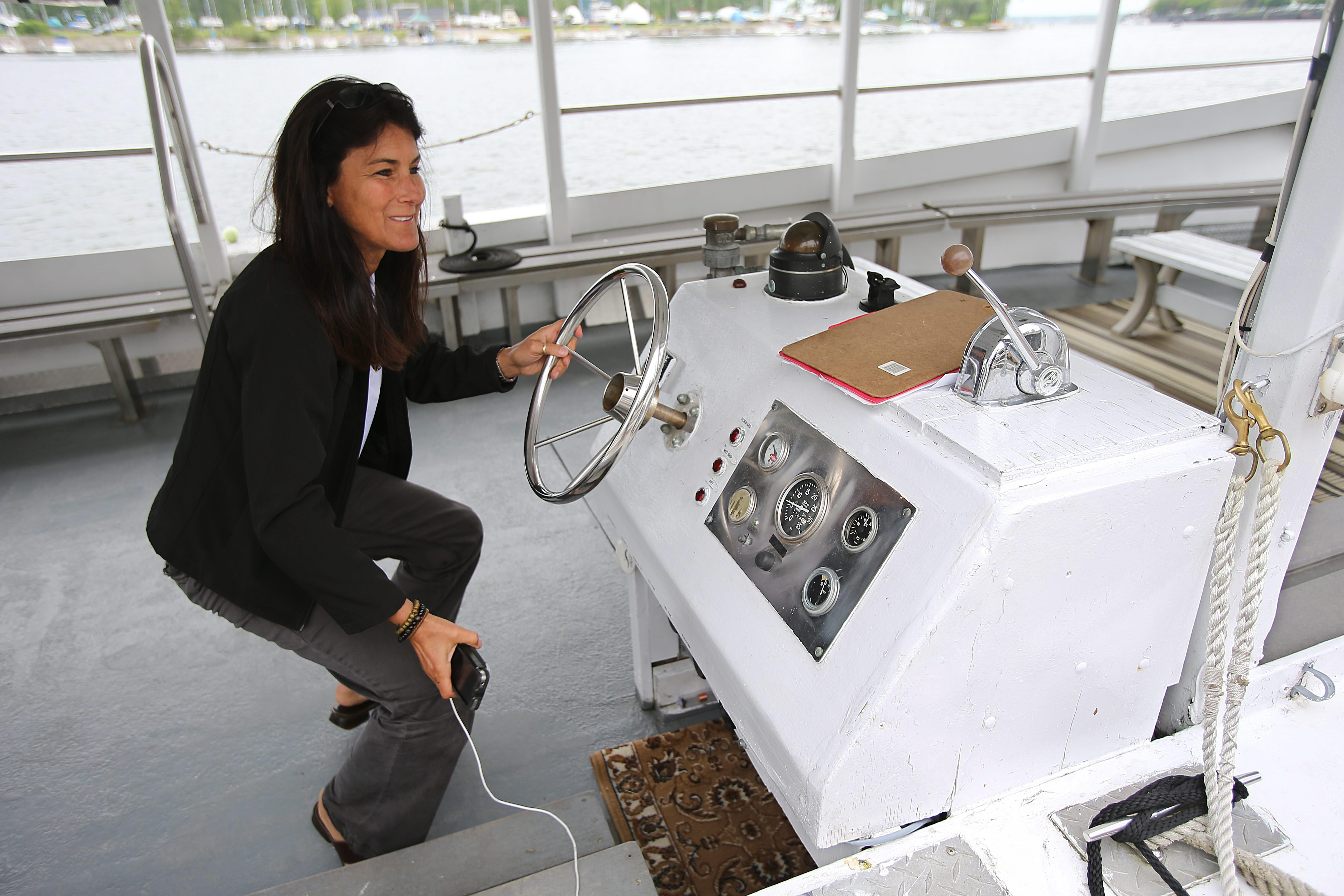 Robin Hoch, co-owner of Niagara River Cruises, enjoys being at the helm.