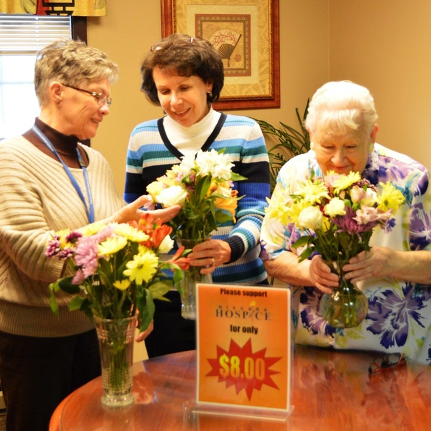 Niagara Hospice volunteers, from left, Mary Dixon, Karen Feger and Sylvia Cooper, think spring as they help prepare for the Annual Niagara Hospice Spring Bouquet Sale from March 7 to 13 in Niagara County.