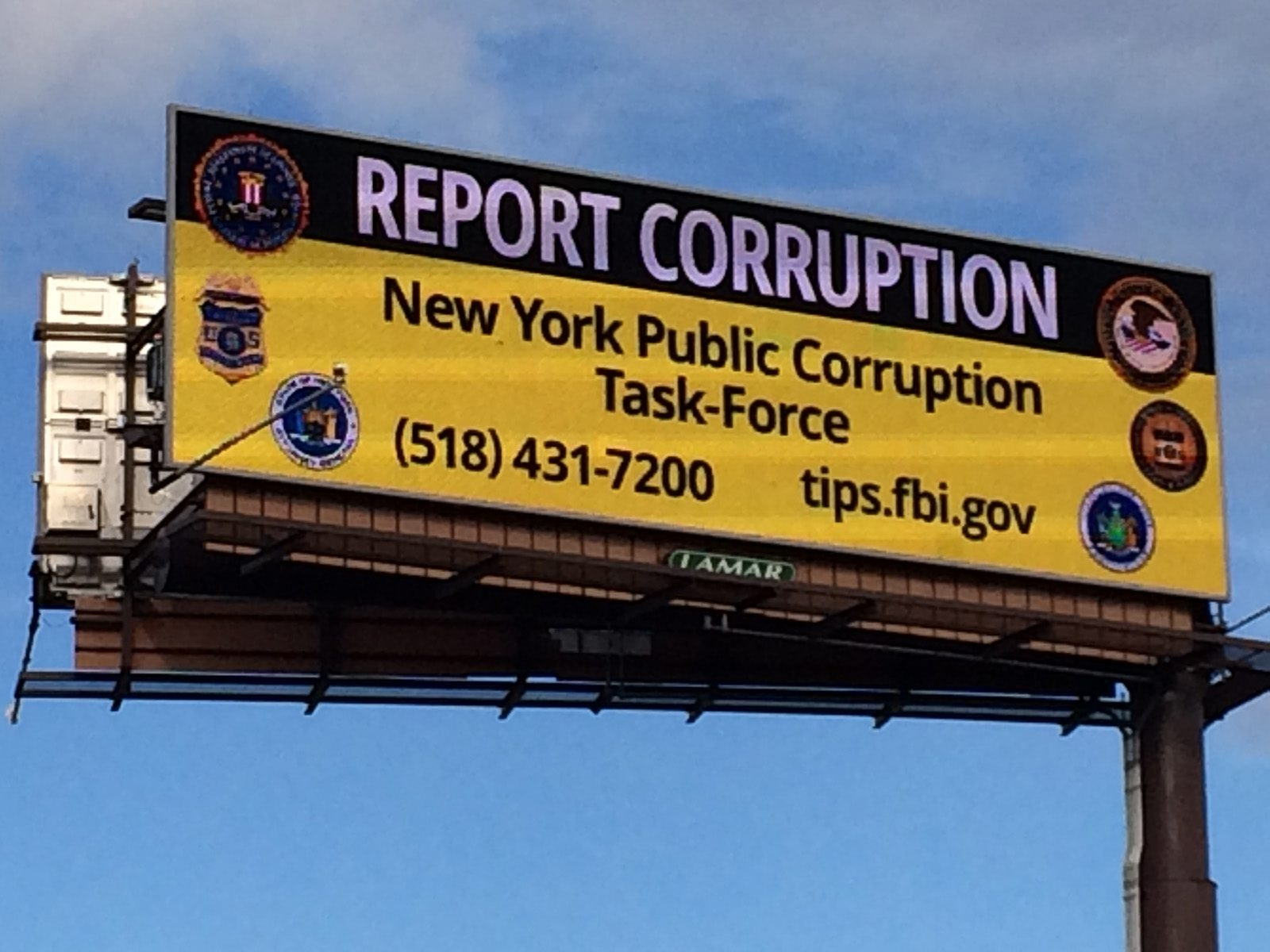 This billboard on the Thruway invites the public's help in rooting out corruption.