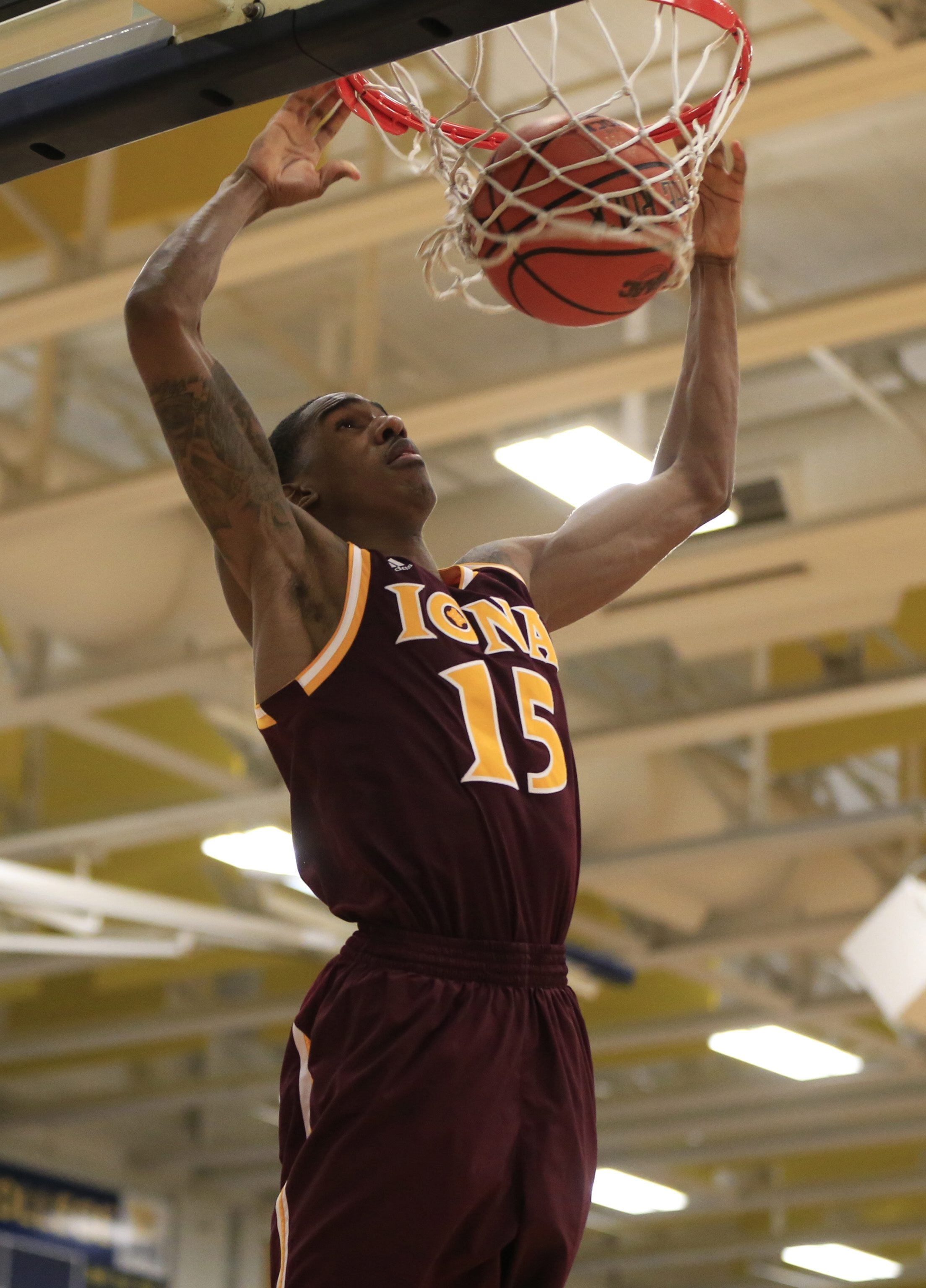 Iona College's Deyshonee Much, a former UB recruit, throws down two of his career-high 30 points.