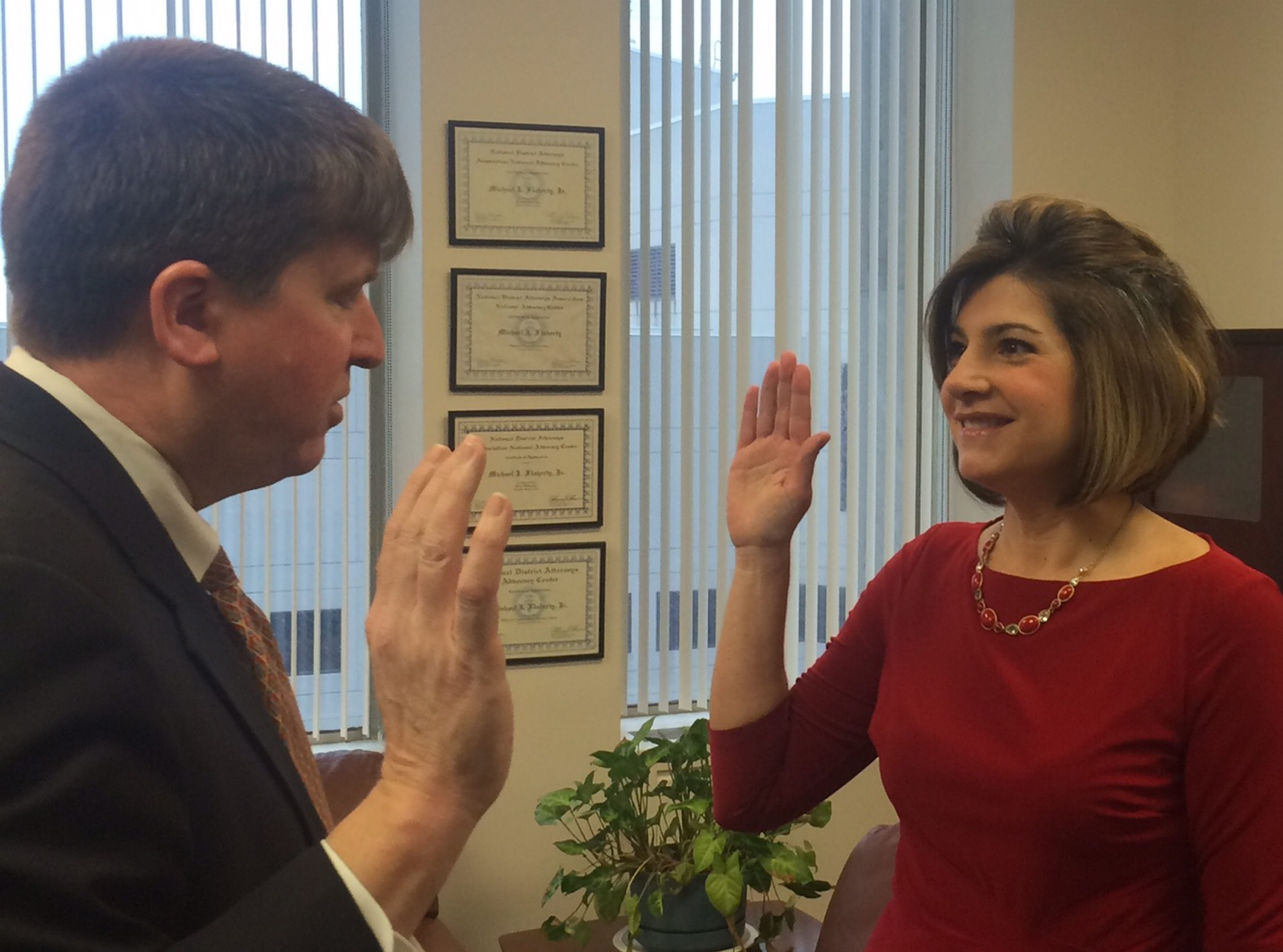 Acting DA Michael Flaherty swears in new hire, Joanna Pasceri, as the department's public information officer, a newly created post.