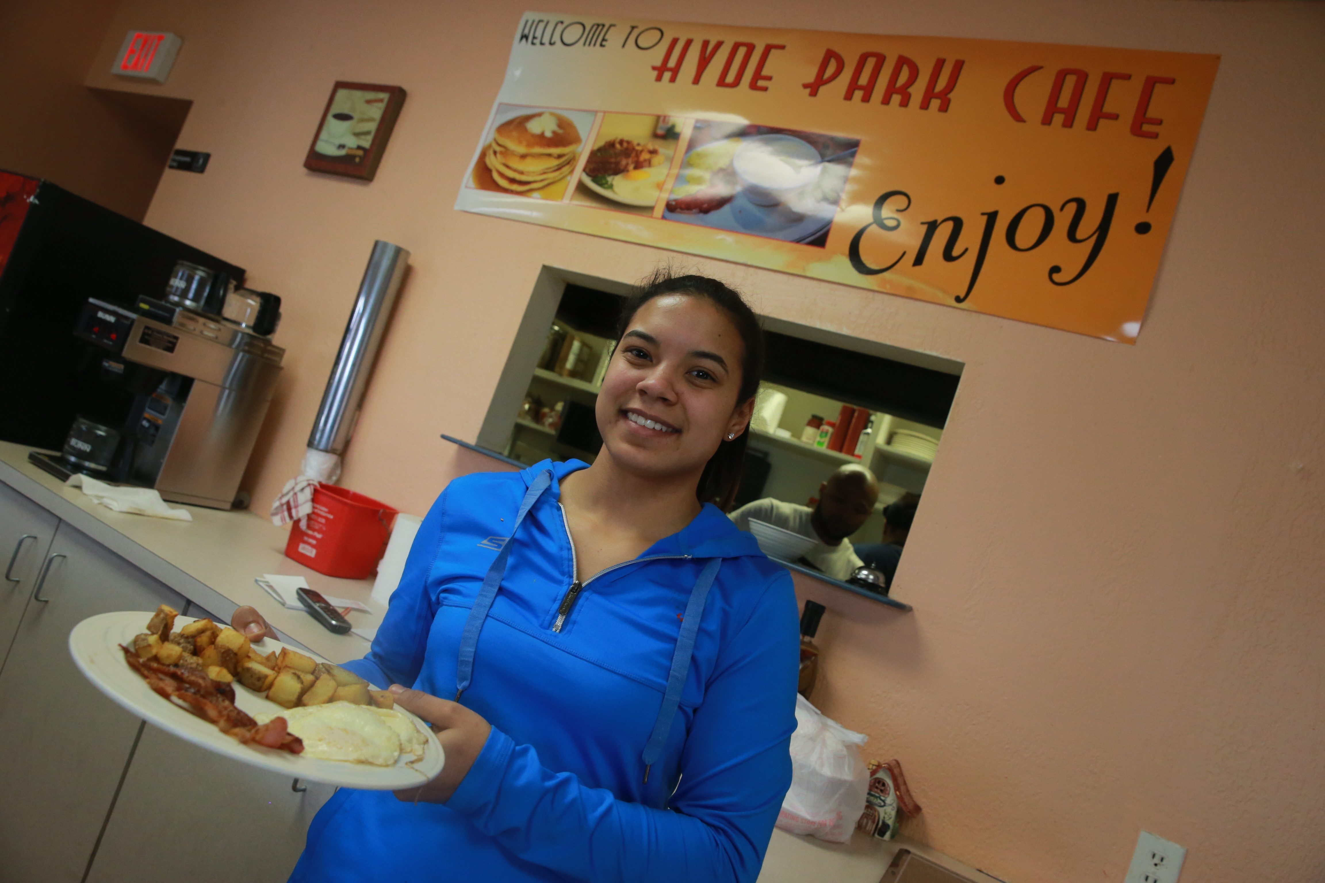 Waitress Marissa Smouse serves up a meal at Niagara Falls' Hyde Park Cafe, a warm and cozy restaurant that specializes in Southern food.
